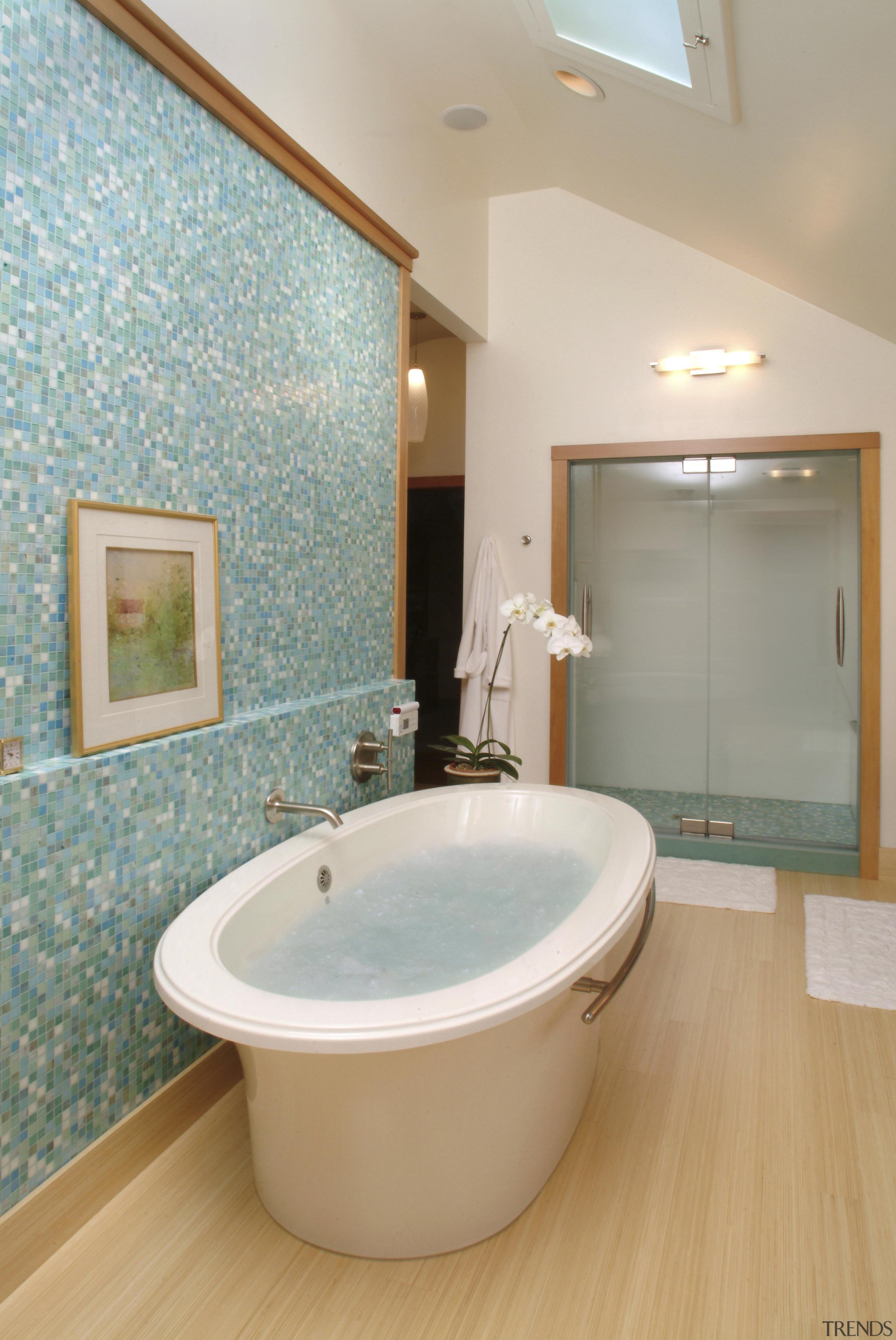 Image of a bathroom designed by an NKBA bathroom, bathtub, floor, flooring, interior design, plumbing fixture, room, tile, toilet seat, gray, orange