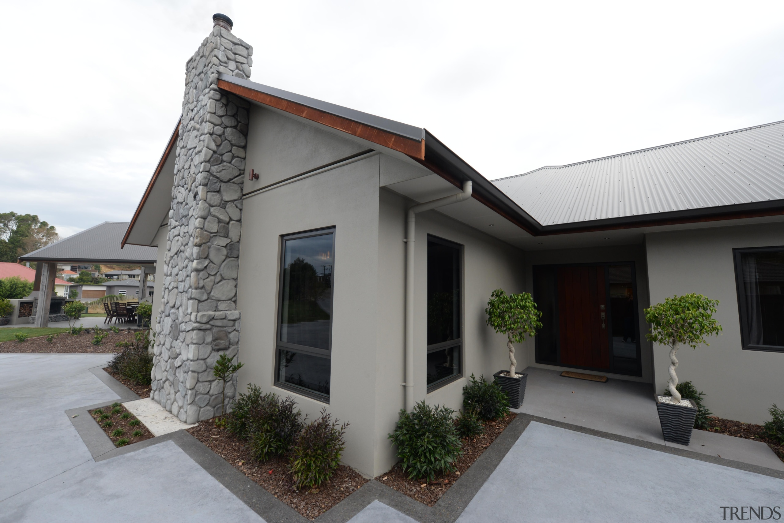 Concrete pre -cast panel home by Fowler Homes cottage, estate, facade, home, house, property, real estate, residential area, roof, window, white, gray