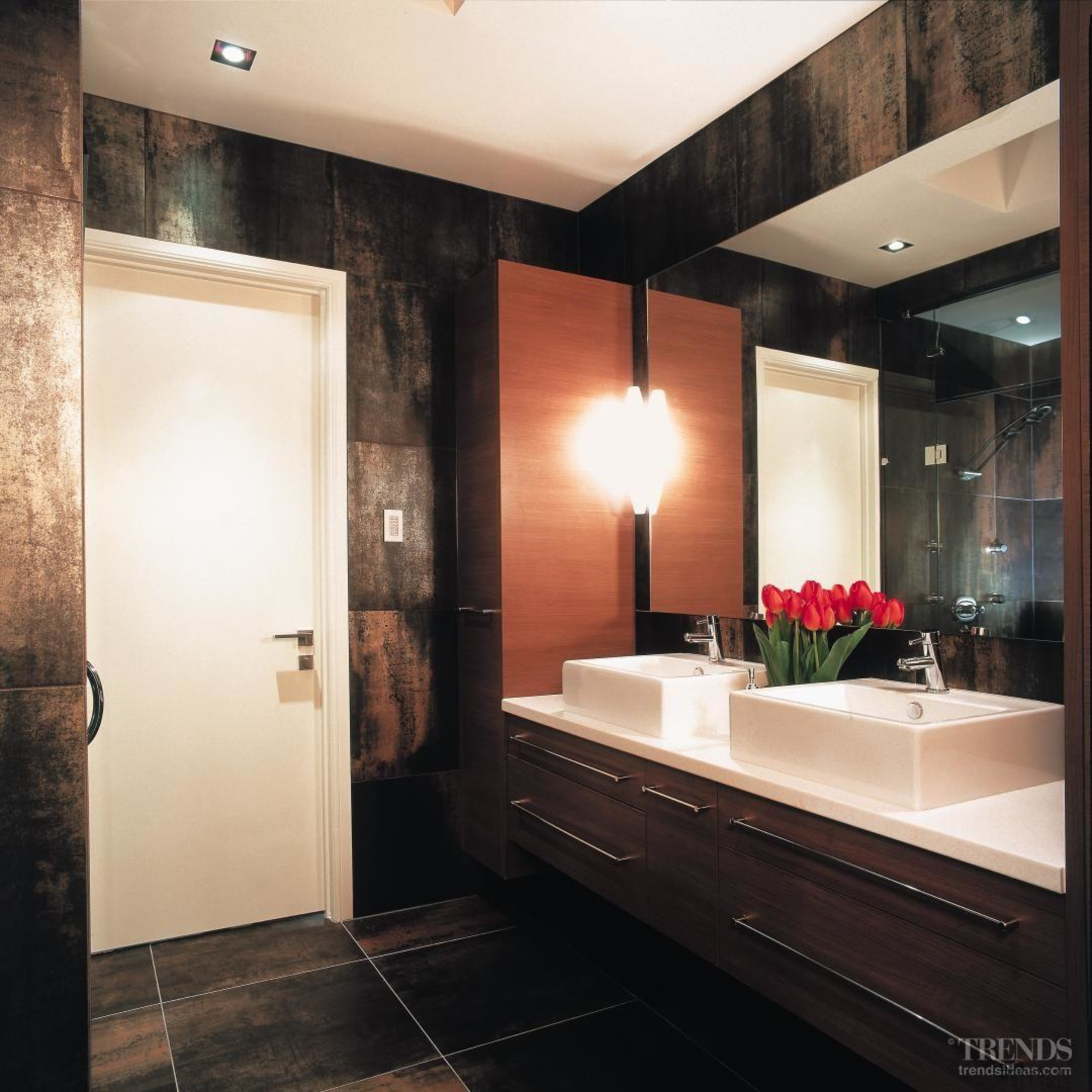 Above: A large mirror and cantilevered vanity enhance bathroom, ceiling, home, interior design, lighting, room, black, white