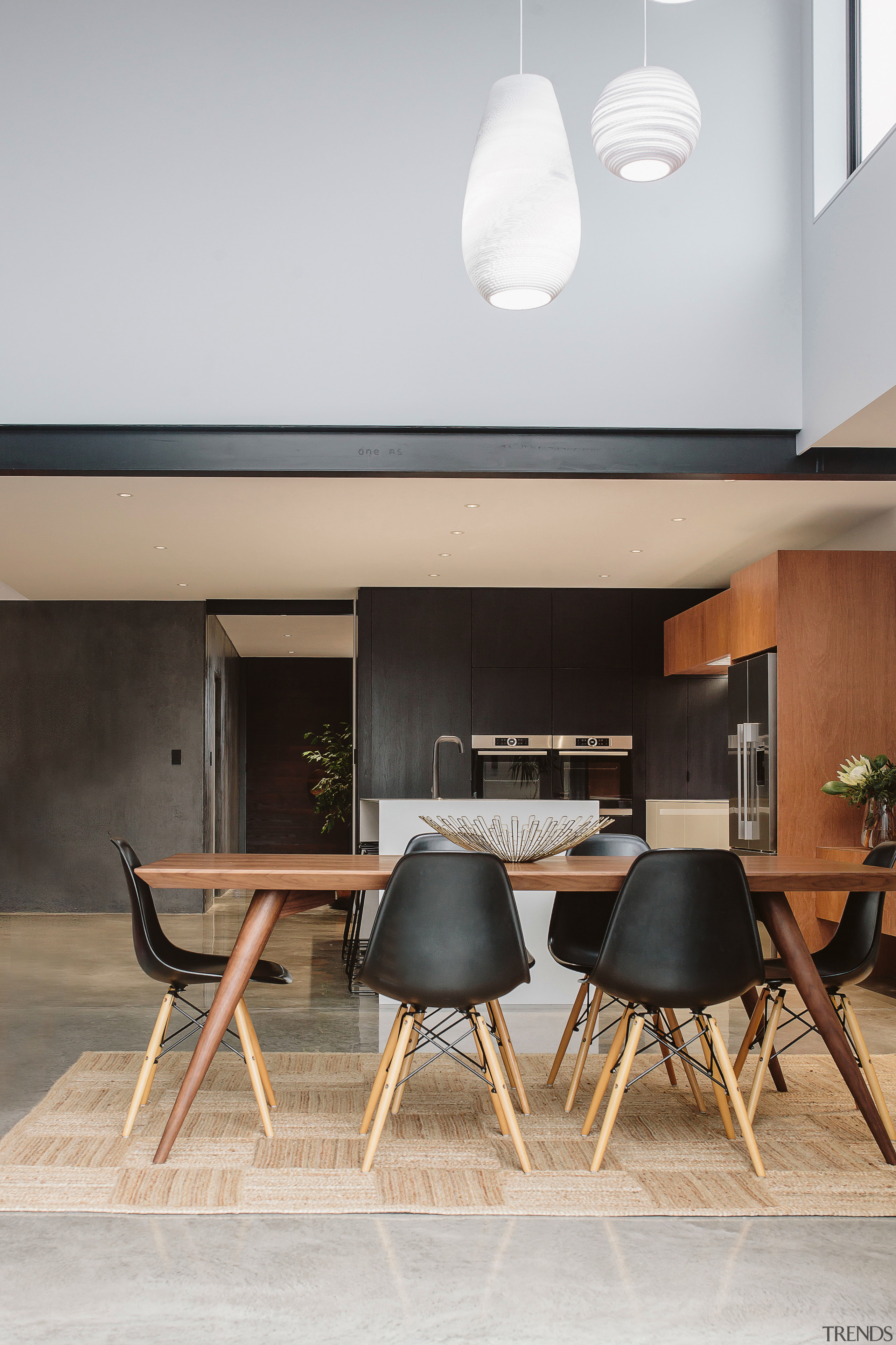 Polished concrete floors ground this kitchens predominant palette ceiling, chair, dining room, furniture, house, interior design, light fixture, product design, table, gray
