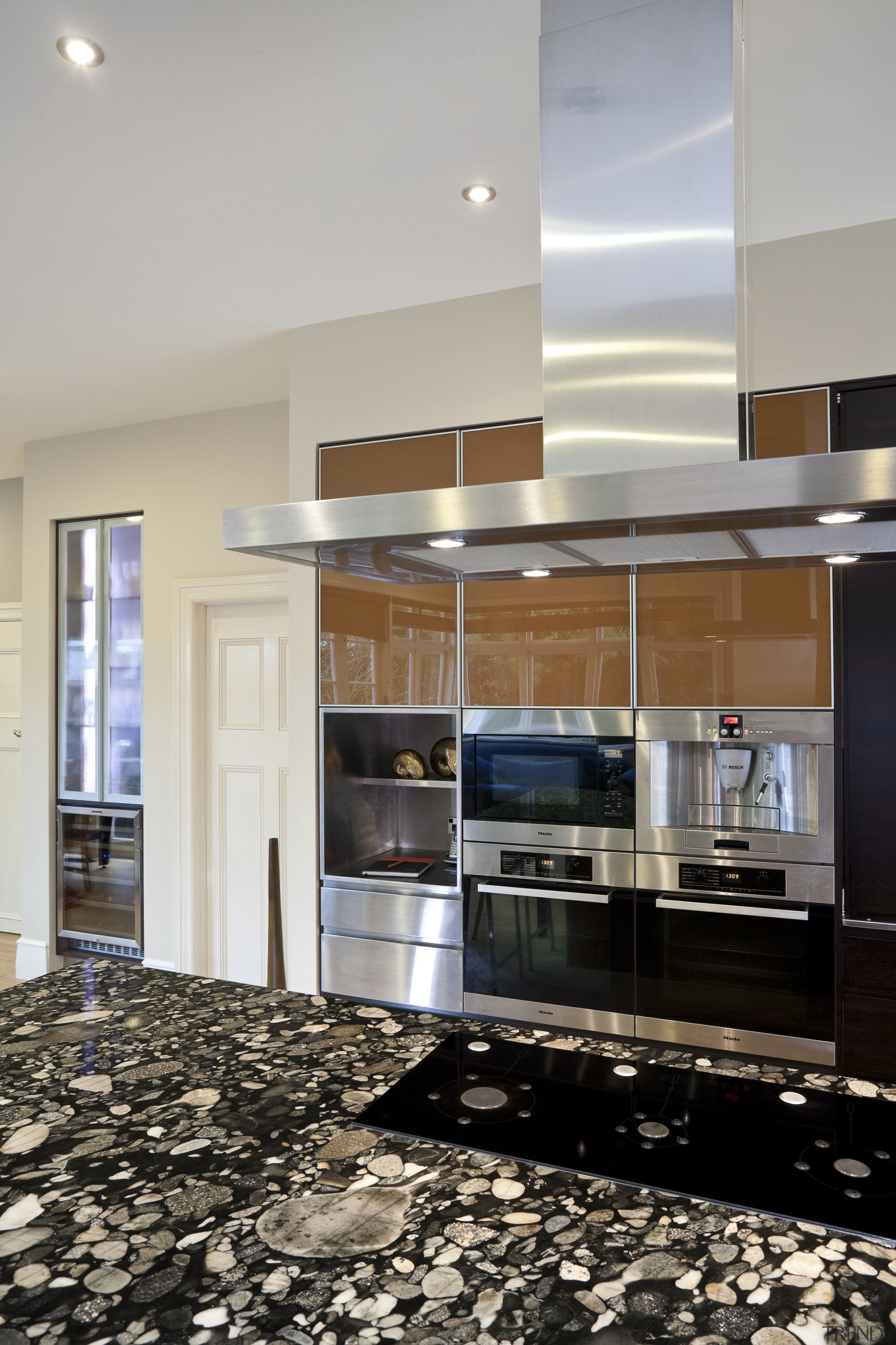 So this area looks good even when the ceiling, countertop, flooring, interior design, kitchen, gray, black