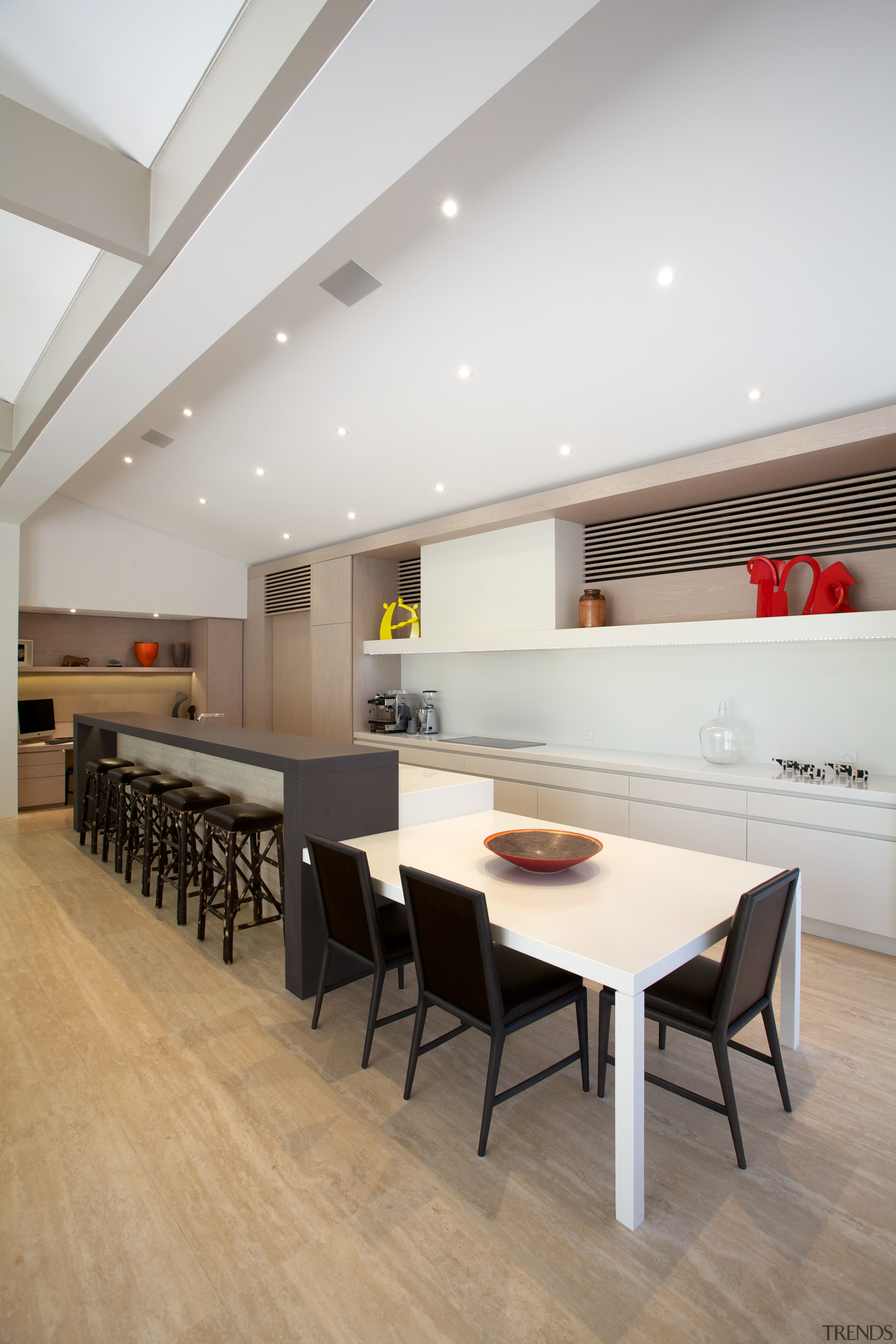 This new kitchen designed by Leon House features architecture, ceiling, dining room, floor, flooring, furniture, interior design, table, wood flooring, gray