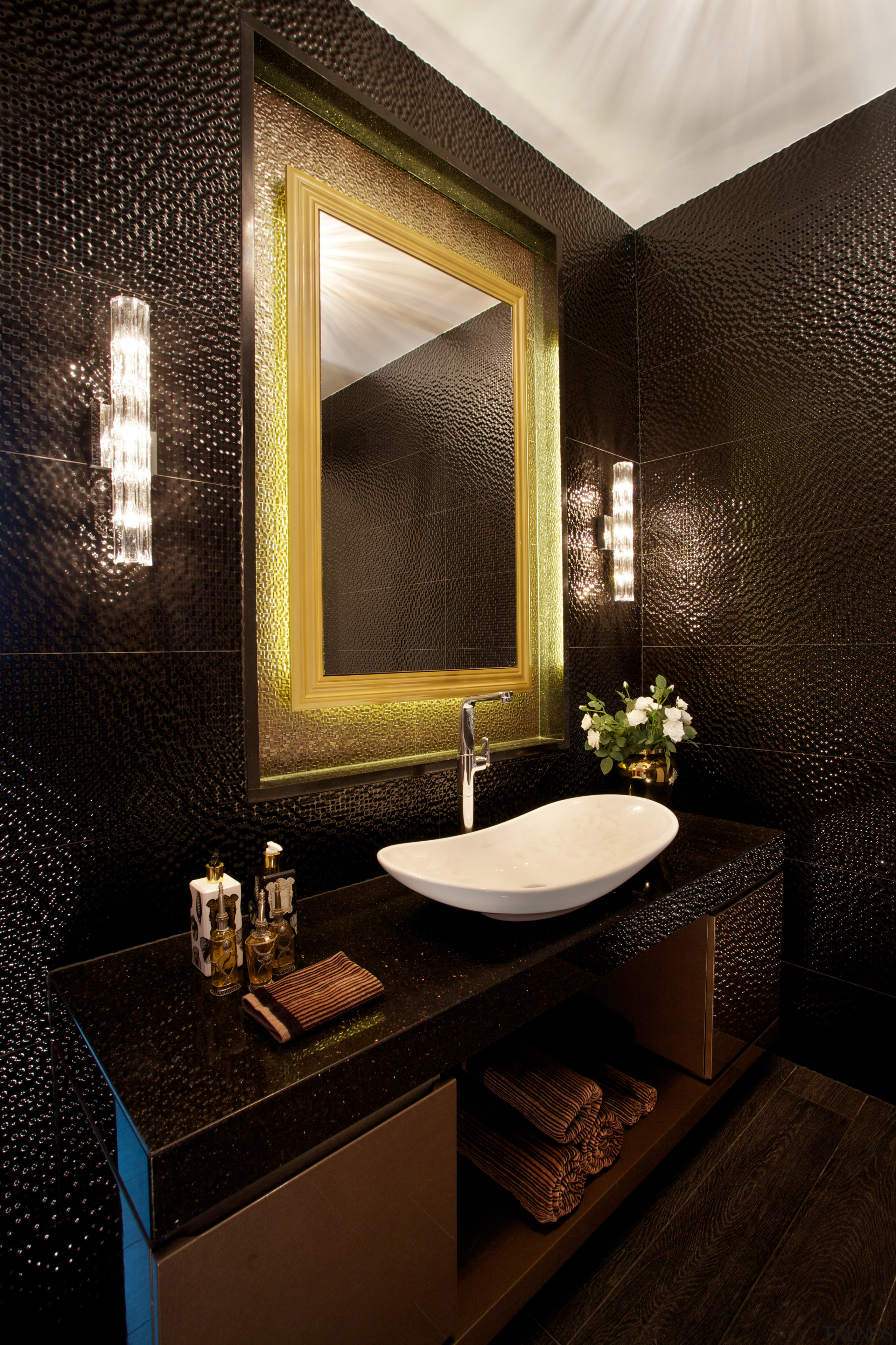 Textural black tiles enhance the glittering look of architecture, bathroom, ceiling, interior design, room, wall, black