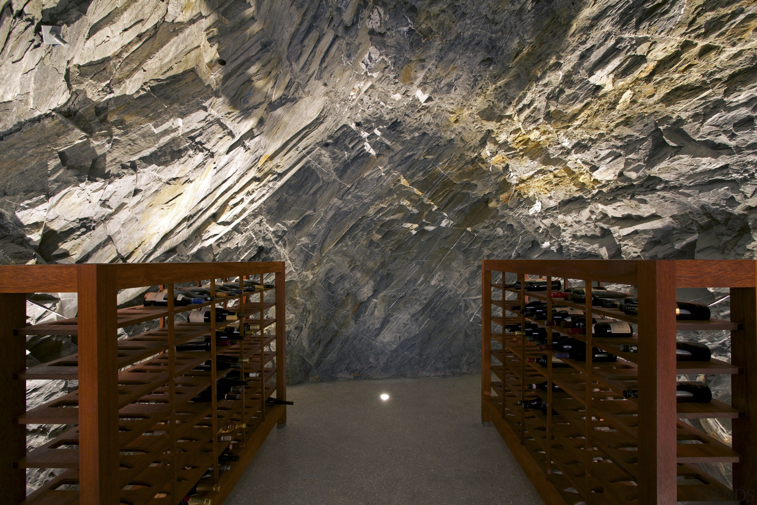 Tunnelled into the rock face, this wine cellar tourist attraction, wood, black, brown