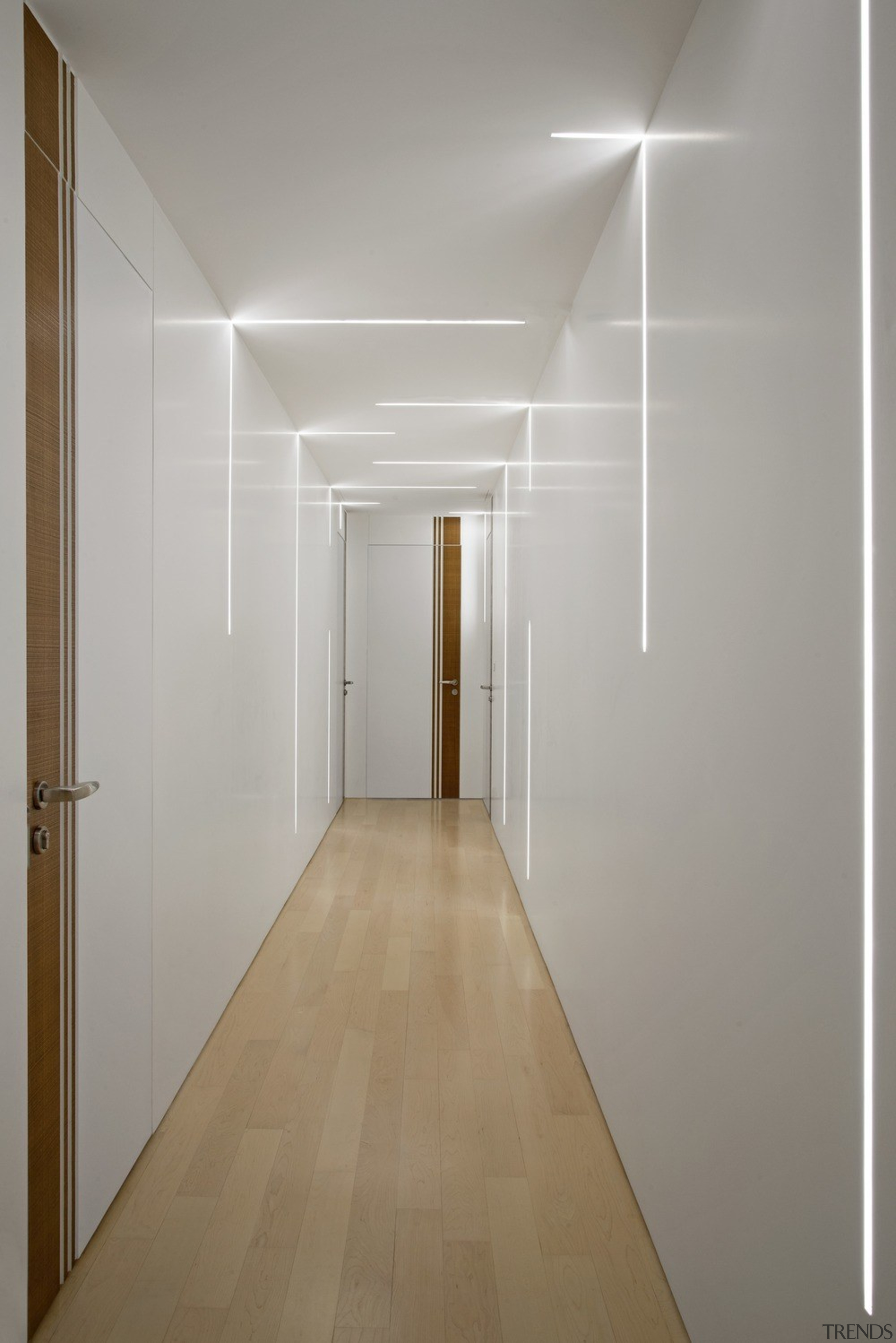 In the hallway, stripes of LED lights from architecture, building, ceiling, door, floor, flooring, glass, hall, house, interior design, line, plaster, property, room, space, wall, gray