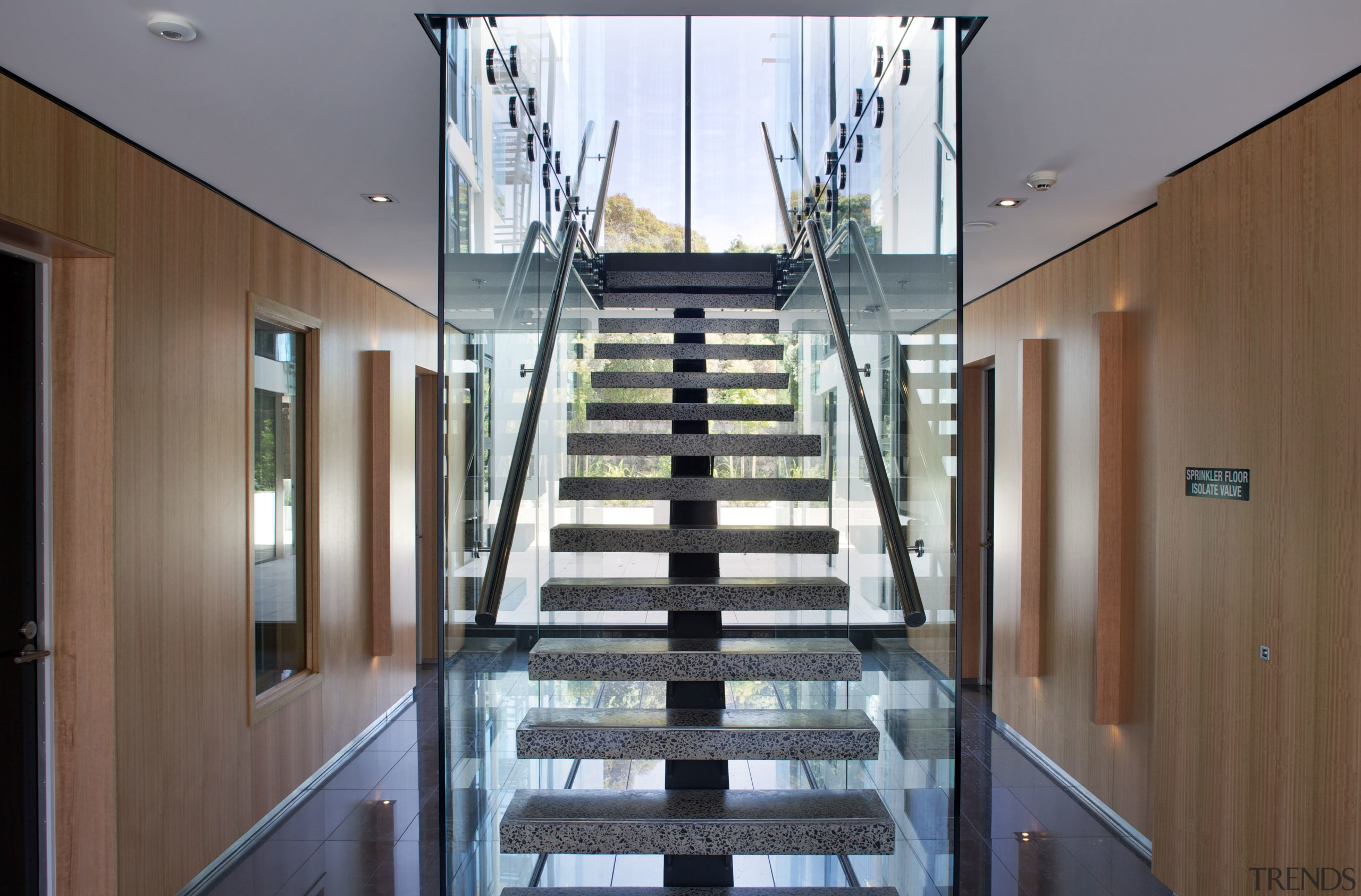 Unlike most apartment buildings, there is a wide architecture, condominium, daylighting, glass, handrail, house, interior design, property, real estate, stairs, window, gray, brown