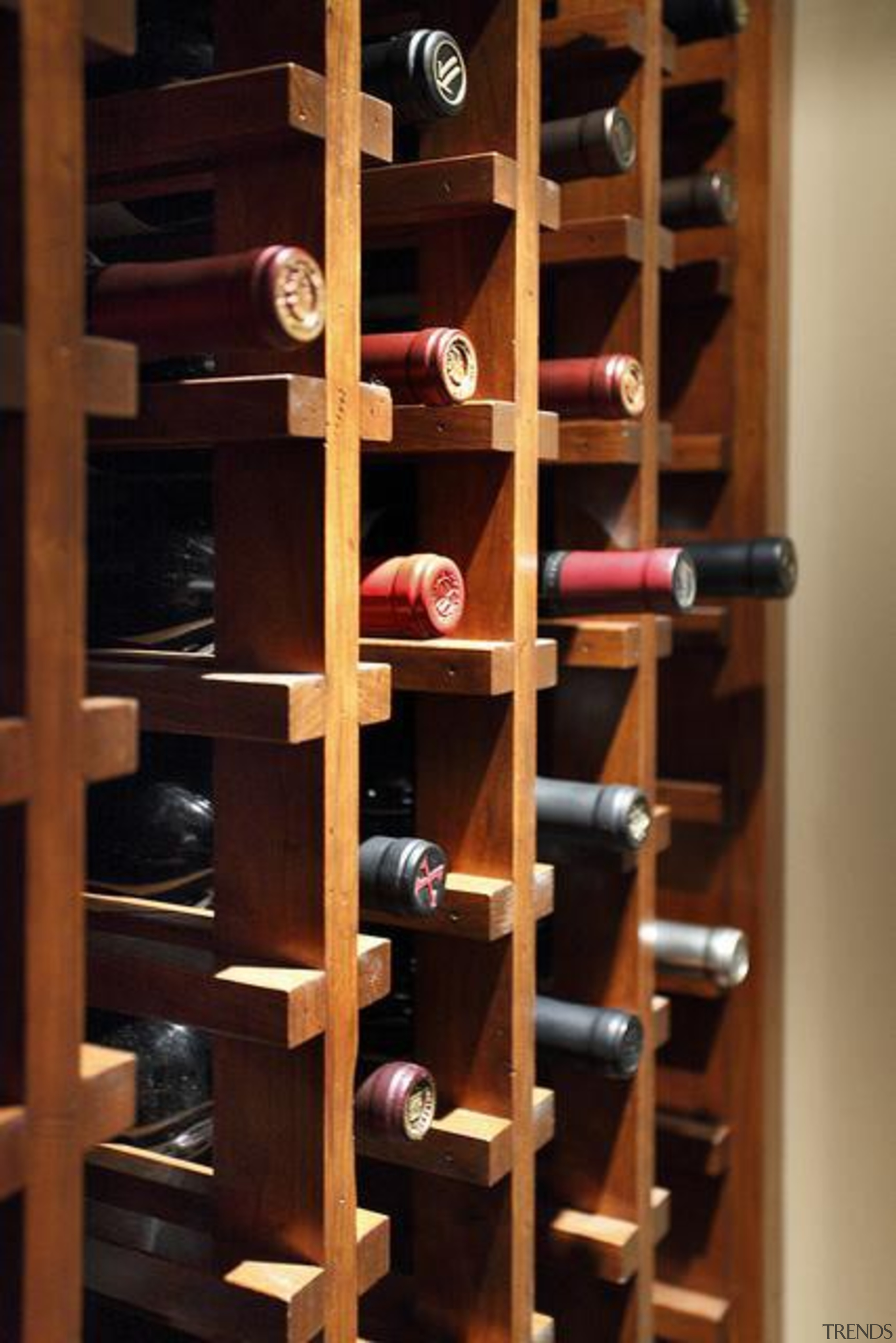 Because of its expansive and wide-open layout, a bookcase, furniture, shelf, shelving, wine cellar, wine rack, winery, black, brown