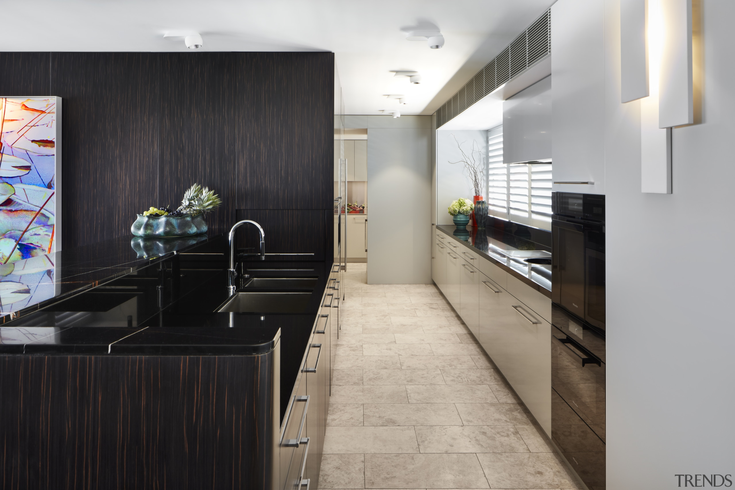 ​​​​​​​This galley kitchen offers ample storage and is architecture, kitchen, cabinetry, countertop, benchtop, flooring, home, house, interior design, kitchen, , tile, gray, black, galley kitchen, Archer Design