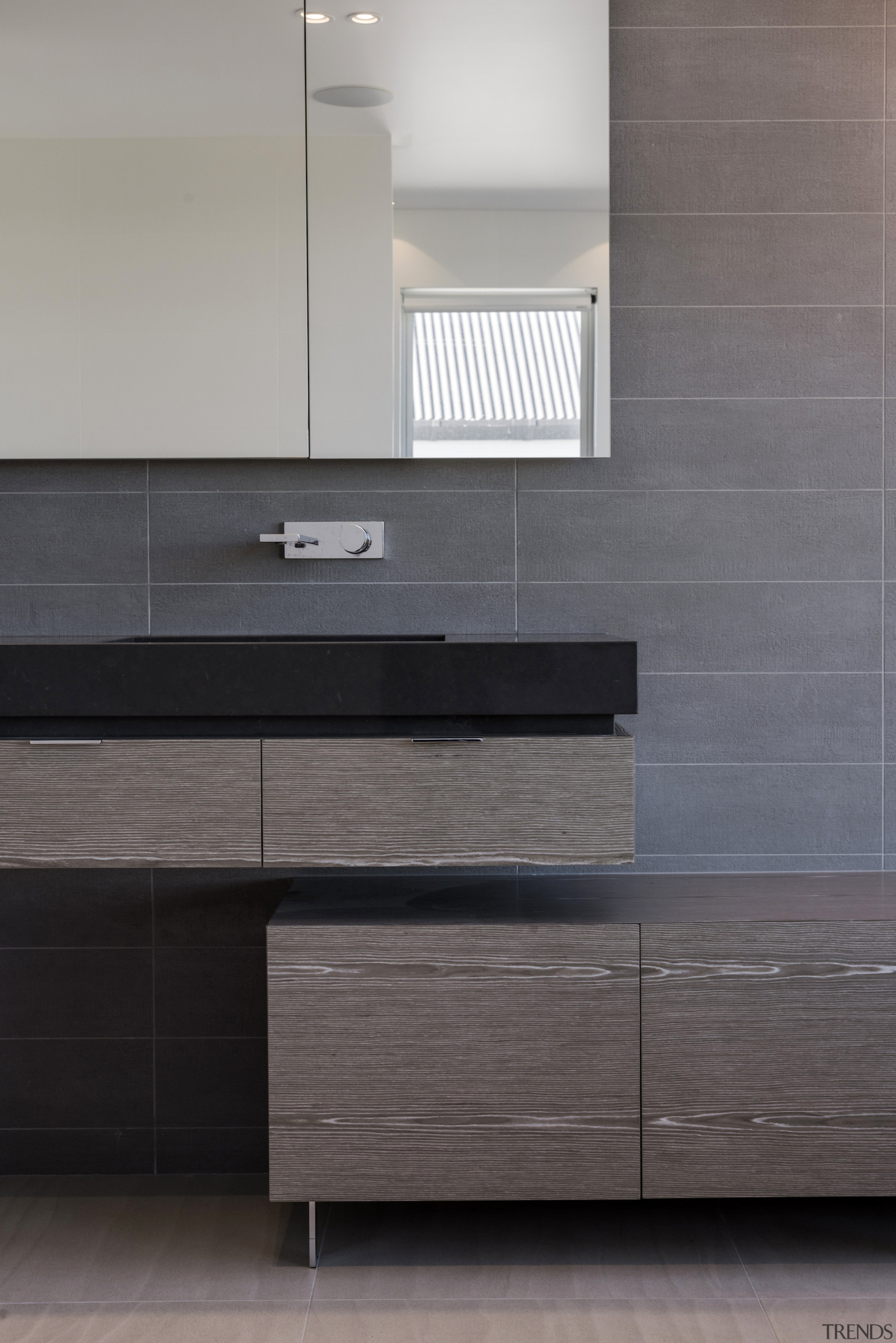 Wood veneer and earthy tiles create an organic angle, bathroom, bathroom accessory, bathroom cabinet, cabinetry, chest of drawers, drawer, floor, flooring, furniture, hardwood, interior design, kitchen, product, sink, tap, tile, wall, wood, wood flooring, wood stain, gray, black