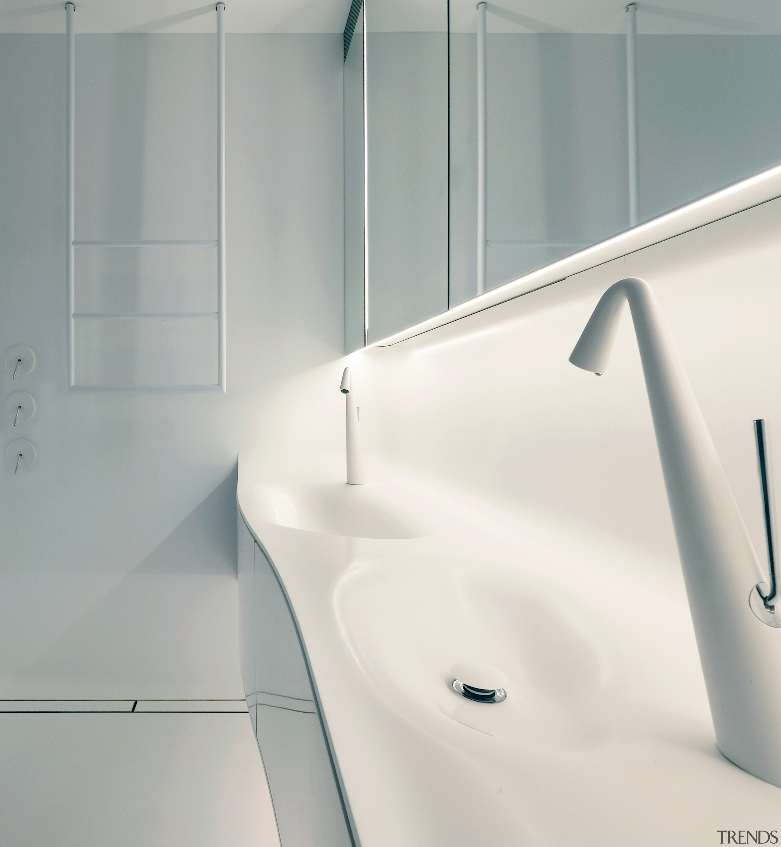For this bathroom, the space-age vanity includes twin architecture, bathroom, bathtub, design, floor, flooring, interior design, line, material property, plumbing fixture, room, sink, tap, tile, white, gray, white