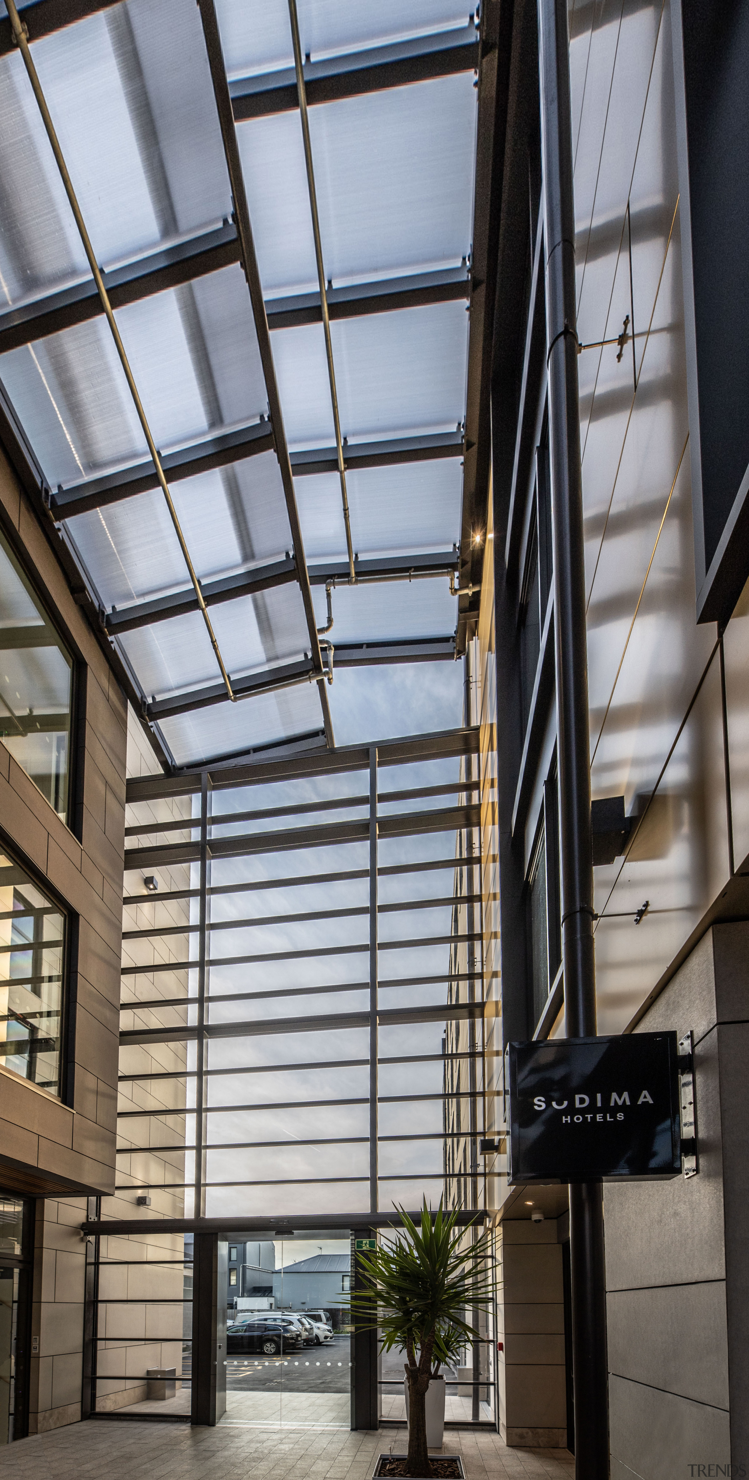 The central atrium runs right through the building architecture, building, commercial building, glass, metal, lobby, Sudima Laneway, Hotel, Office space,  Ignite Architects