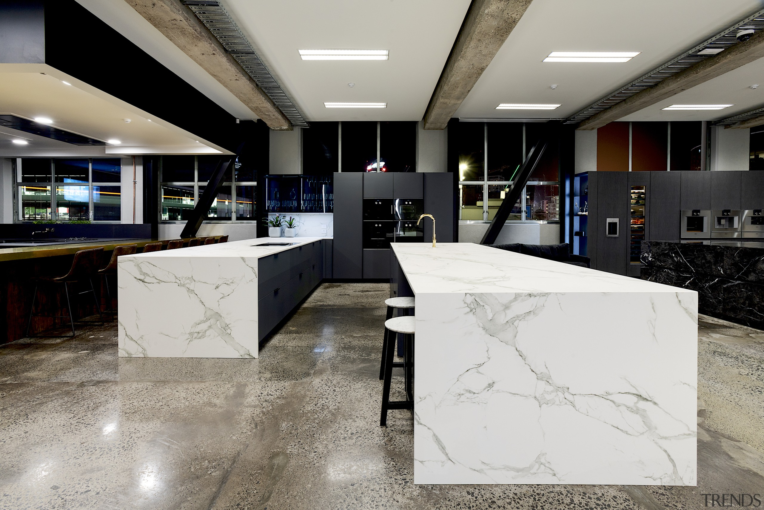 Cool stone surfaces meet strong forms in the gray, black
