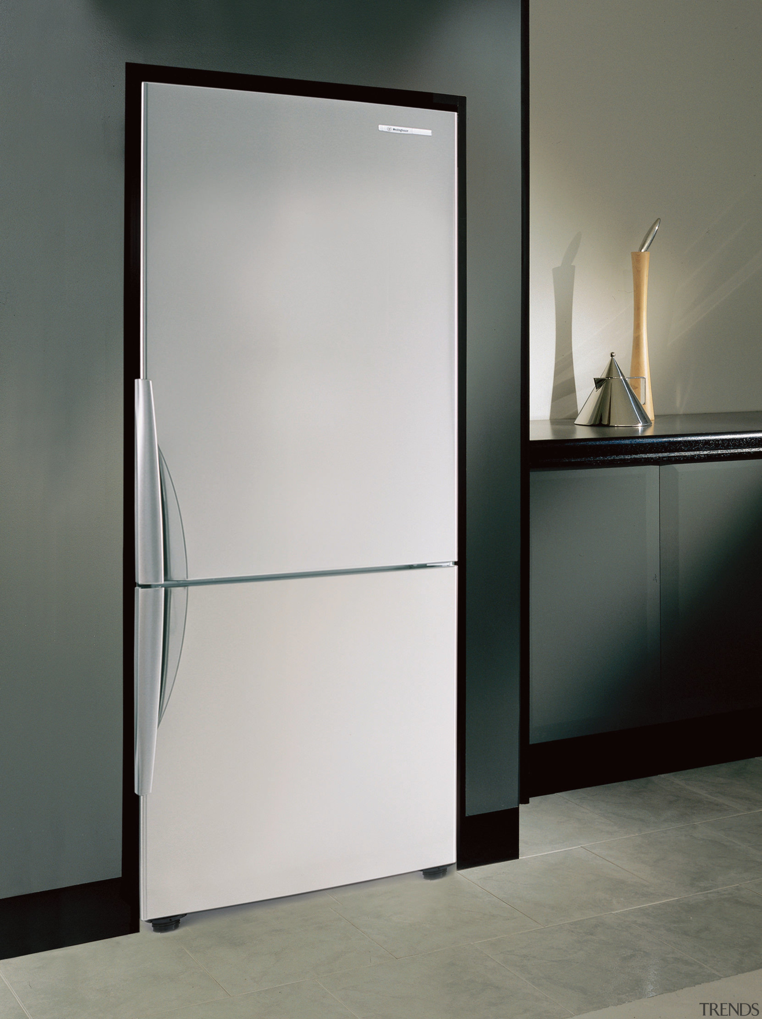 A view of this kitchen featuring the latest door, glass, product design, gray