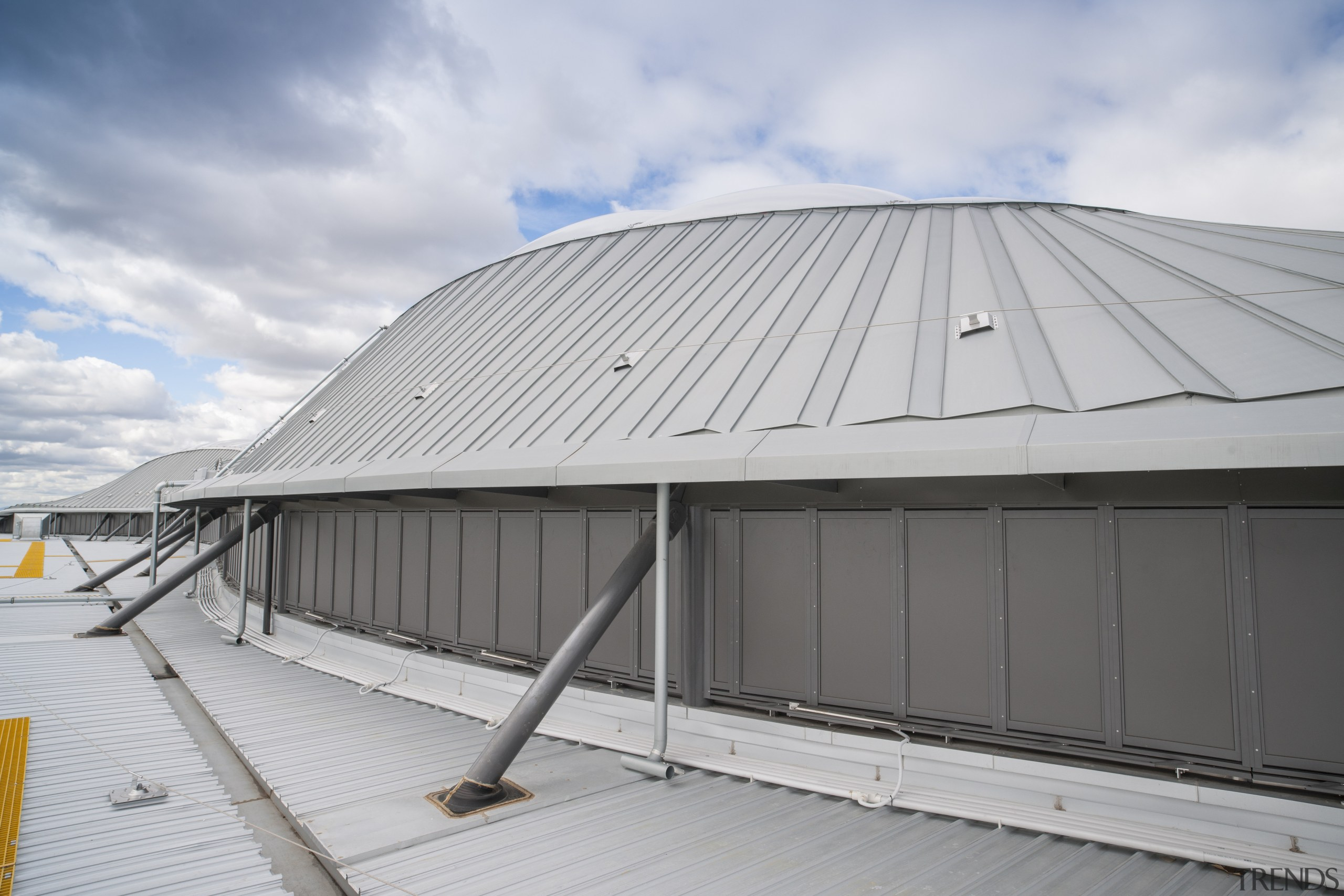 The roof was chosen in part for its architecture, building, cloud, daylighting, daytime, line, roof, shed, sky, structure, gray