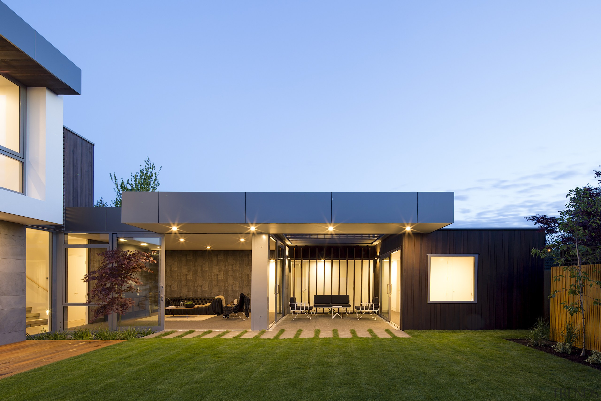 The outdoor room separates the home's fourth bedroom