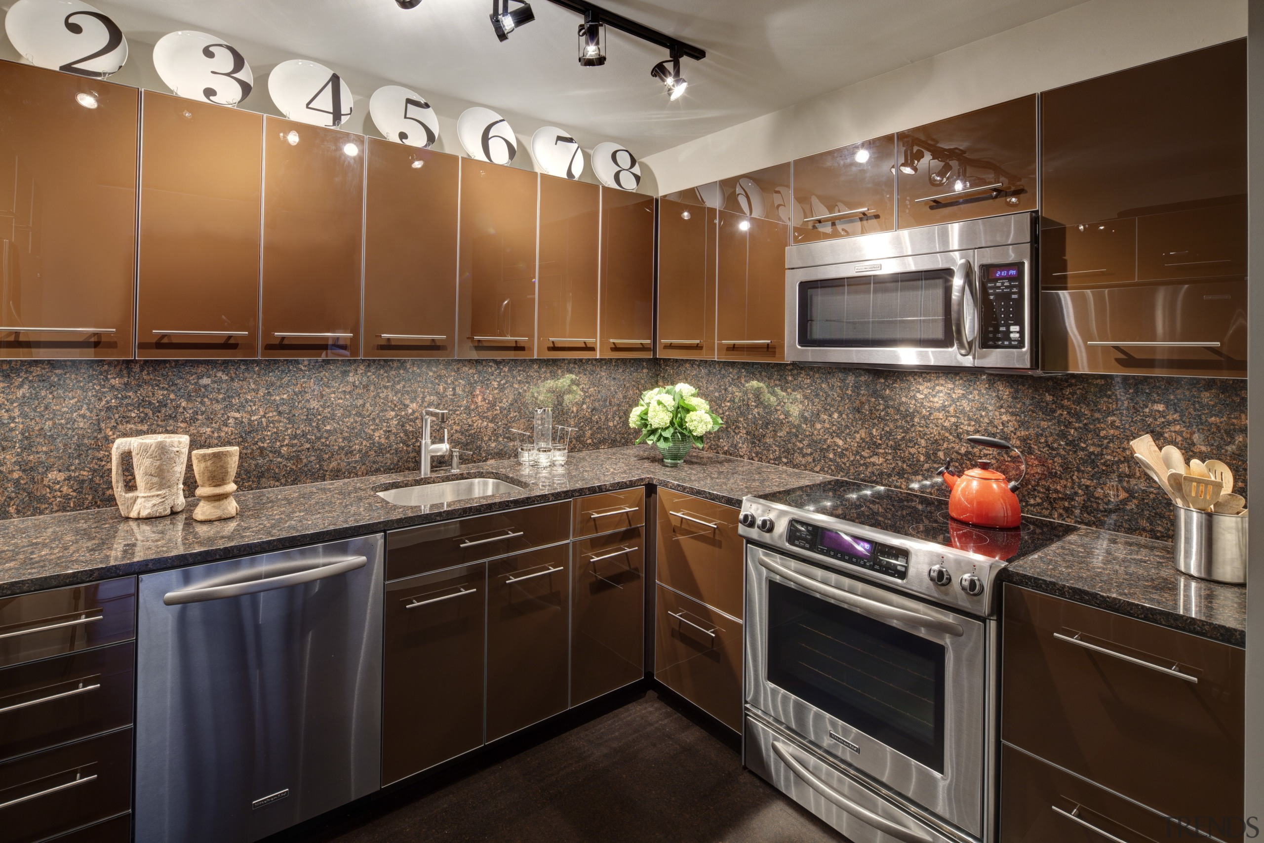 Contemporary apartment kitchen with reflective cabinetry and brown cabinetry, countertop, cuisine classique, flooring, hardwood, home, interior design, kitchen, room, under cabinet lighting, brown, gray