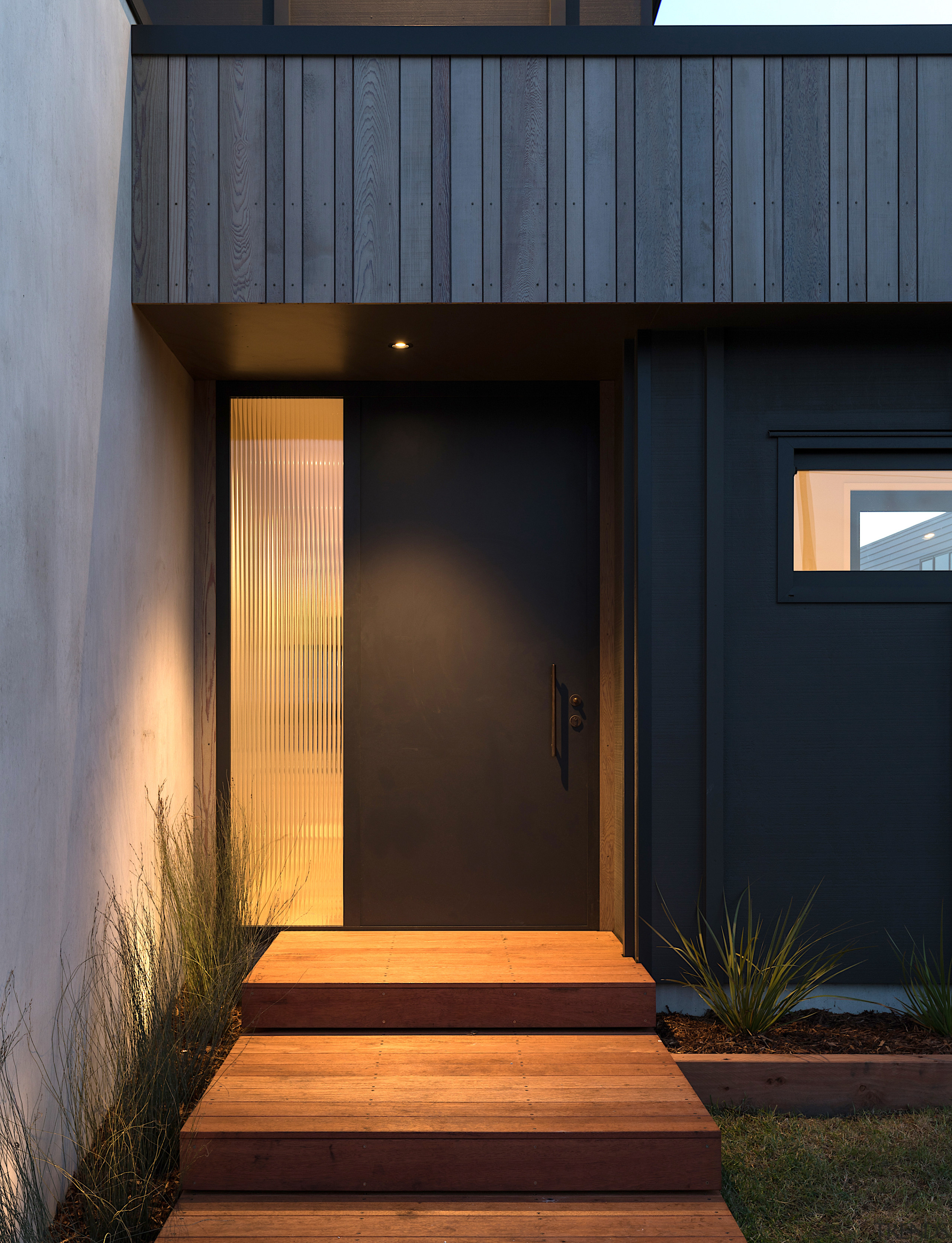 Entry into the home is alongside a concrete