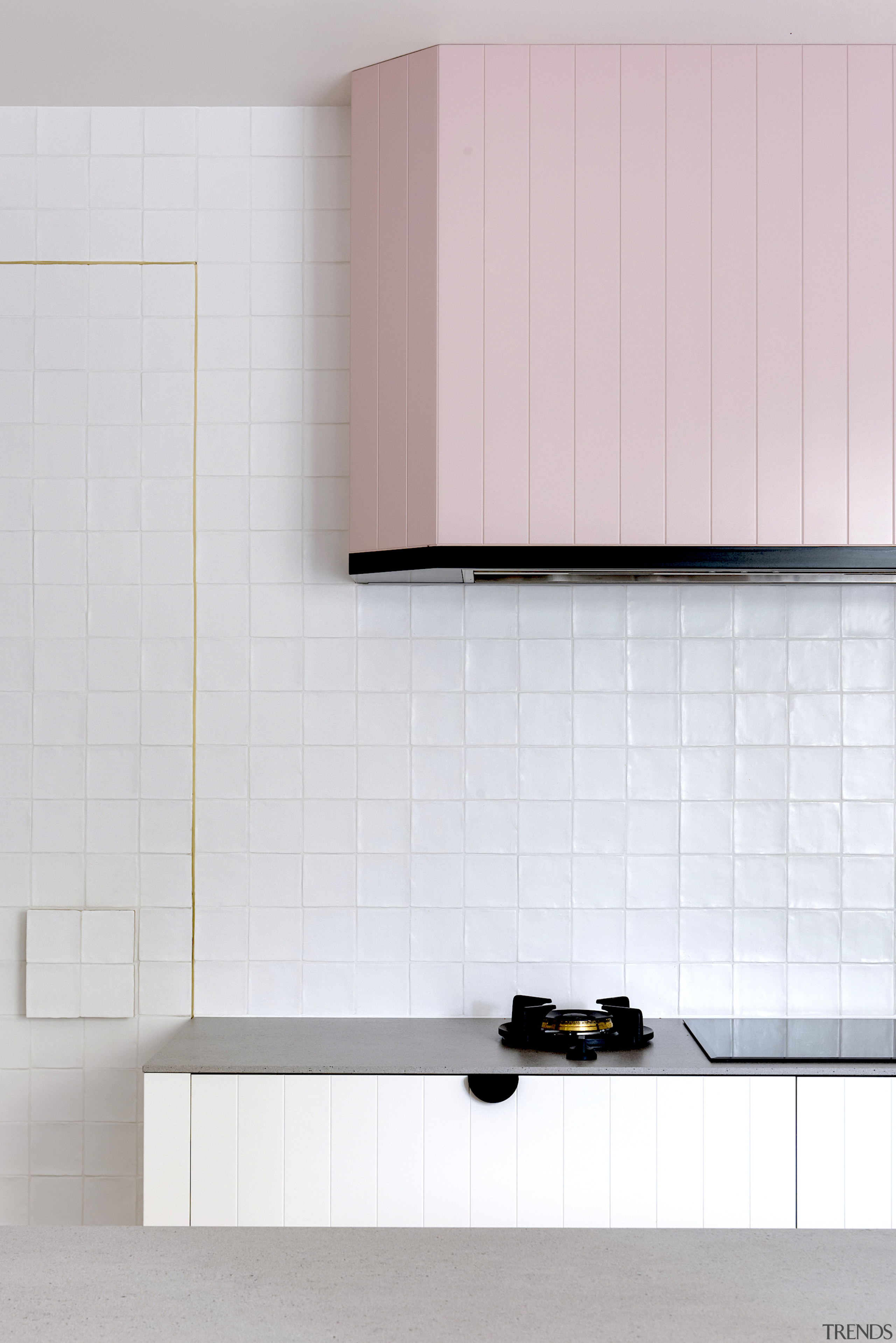 Handmade warm white butcher tiles were introduced on gray, white