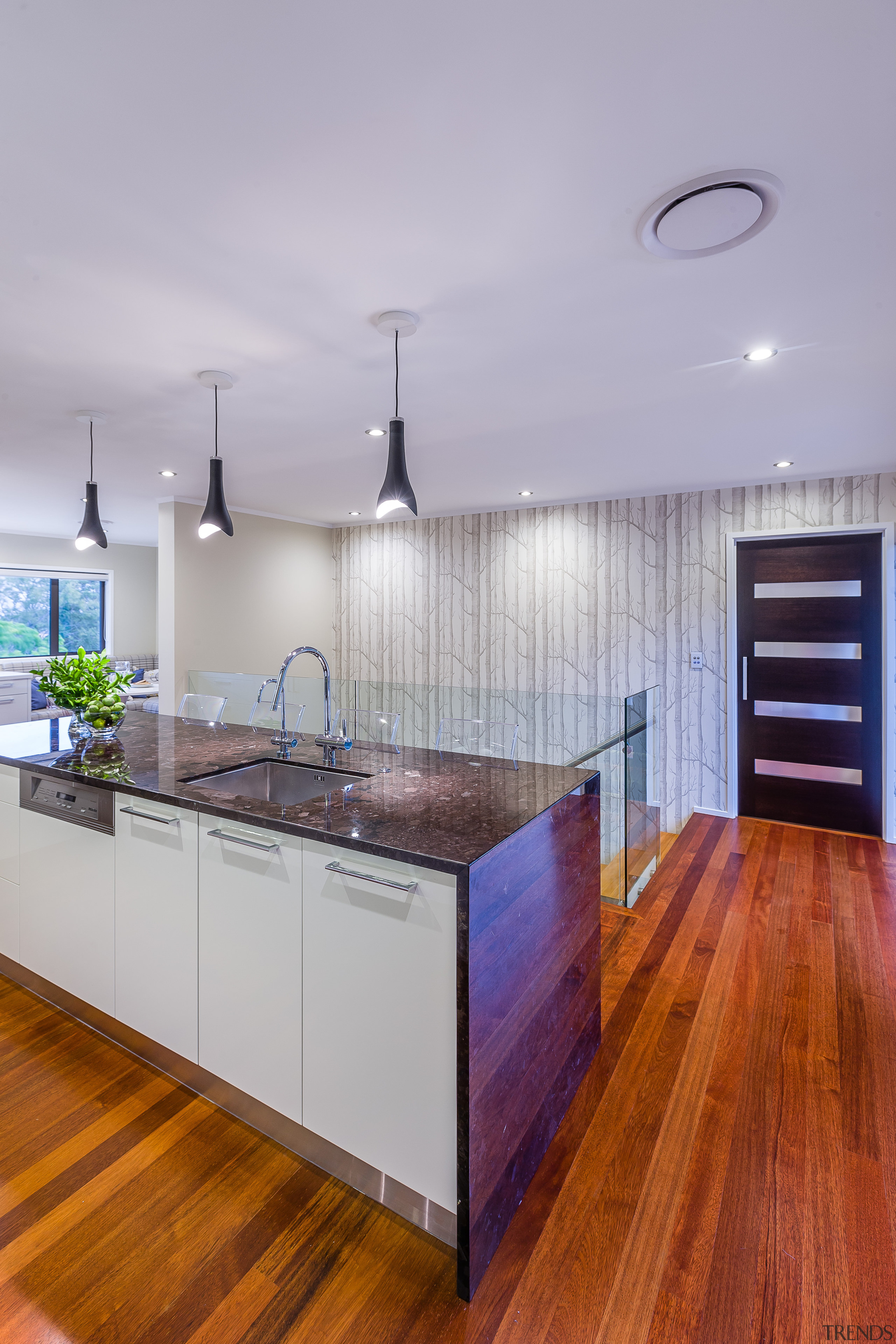 Contemporary kitchen renovation with granite waterfall island and architecture, cabinetry, ceiling, countertop, floor, flooring, hardwood, home, interior design, kitchen, laminate flooring, real estate, room, wood, wood flooring, gray