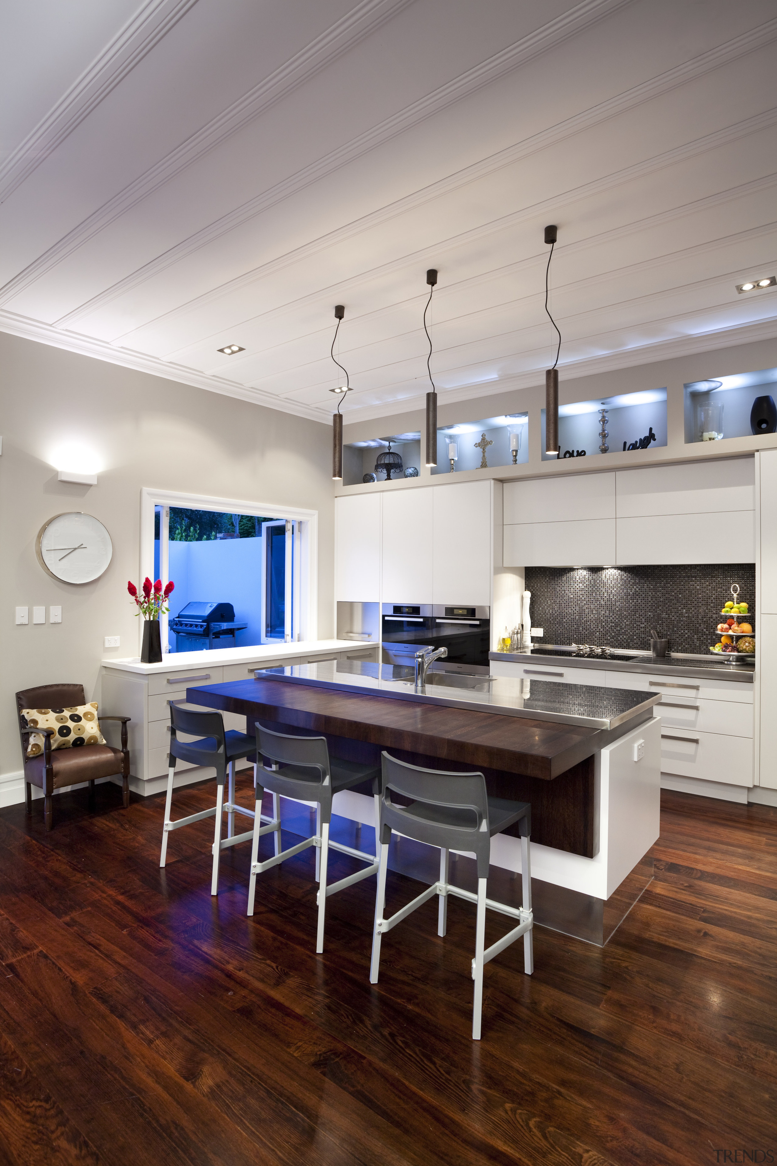 white island with stainless steel benchtop, dark quartz ceiling, countertop, floor, flooring, hardwood, interior design, kitchen, laminate flooring, living room, loft, room, table, wood, wood flooring, gray