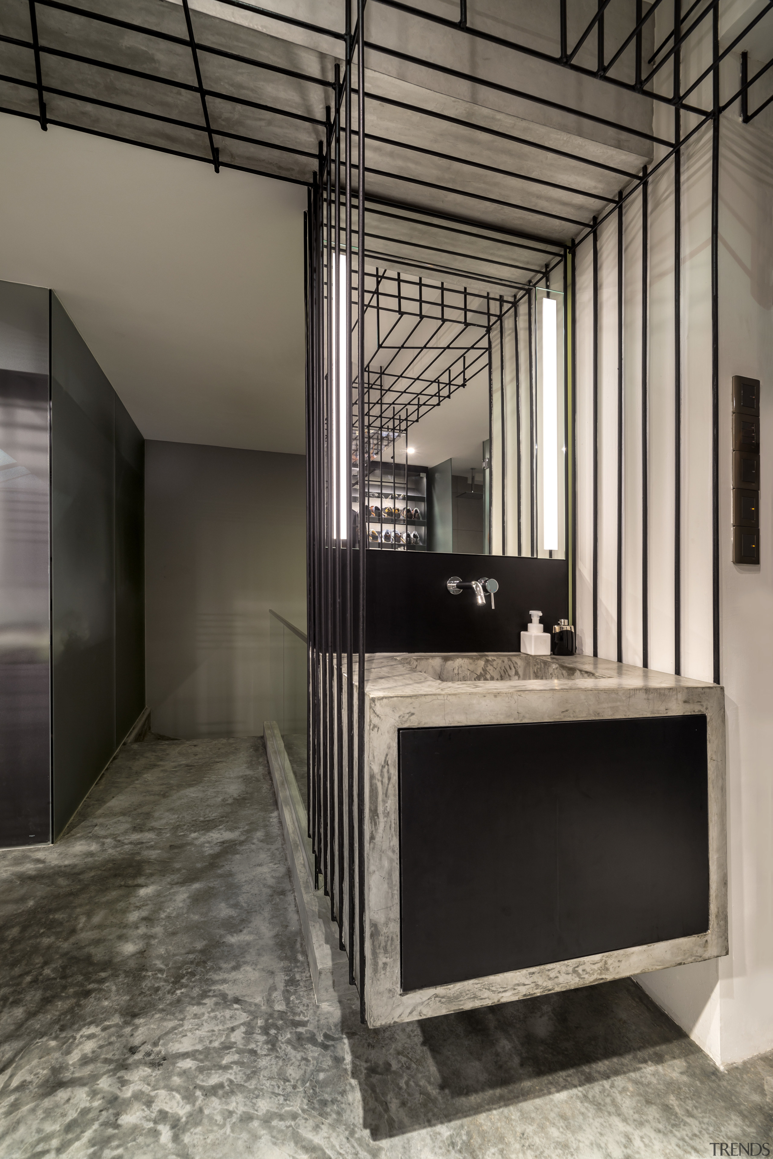 Steel framework appears to support this floating vanity architecture, ceiling, floor, flooring, interior design, gray, black
