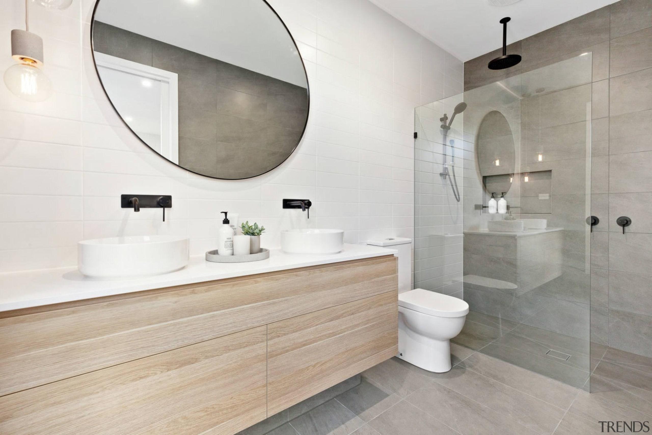 This large bathroom features a rain shower head bathroom, floor, flooring, interior design, product design, room, sink, tap, tile, gray