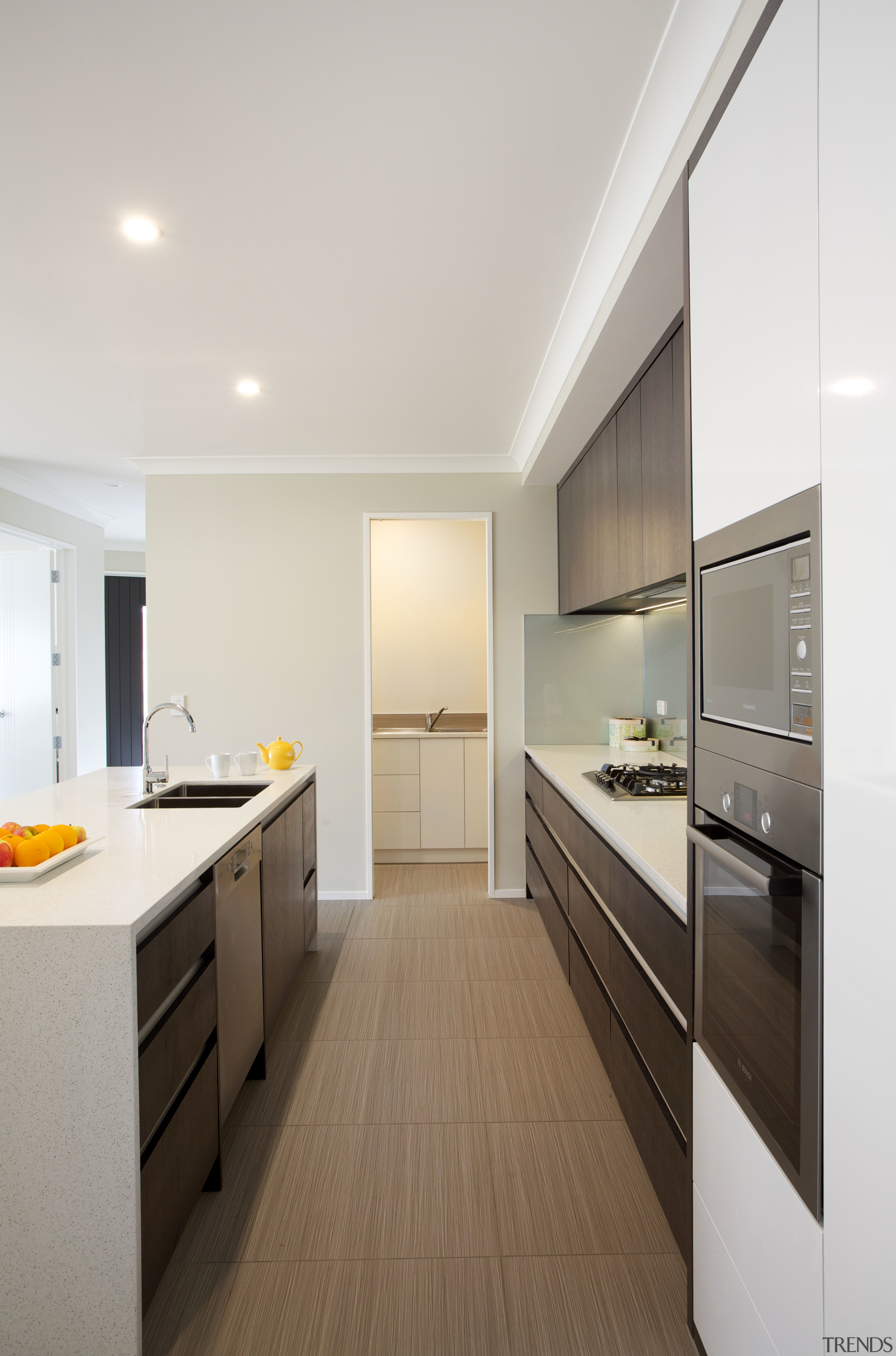 At one end of this kitchen, a scullery cabinetry, countertop, floor, interior design, kitchen, real estate, room, white