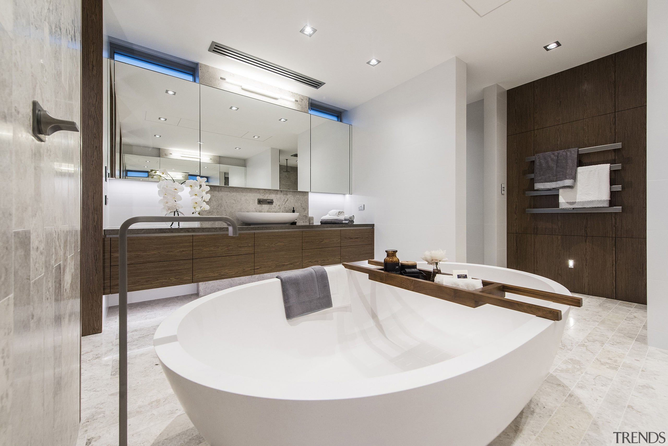 The toilet cubicle is tucked away to the architecture, bathroom, interior design, kitchen, real estate, sink, gray