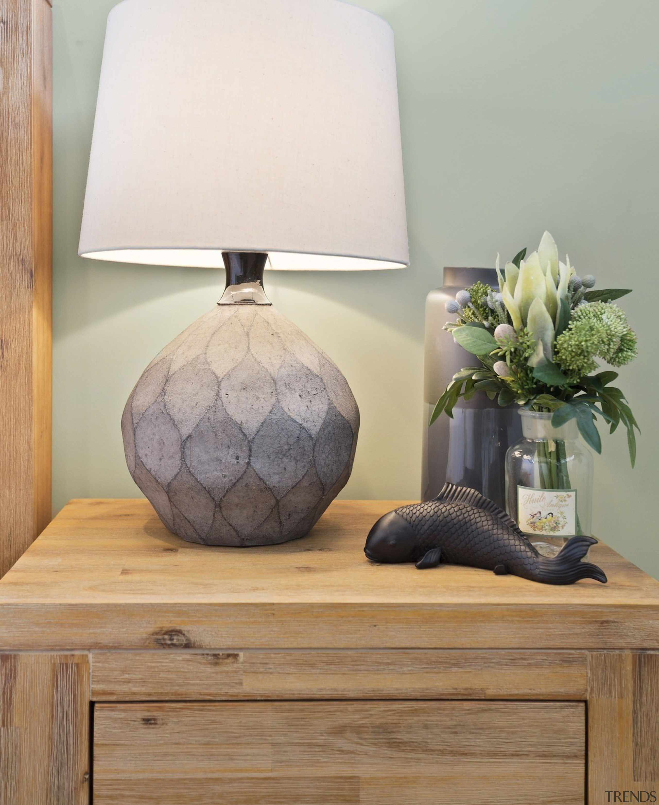 Raw Earth tones are pleasing to the eye furniture, lamp, lampshade, light fixture, lighting, lighting accessory, product design, table, vase, wood, gray, brown