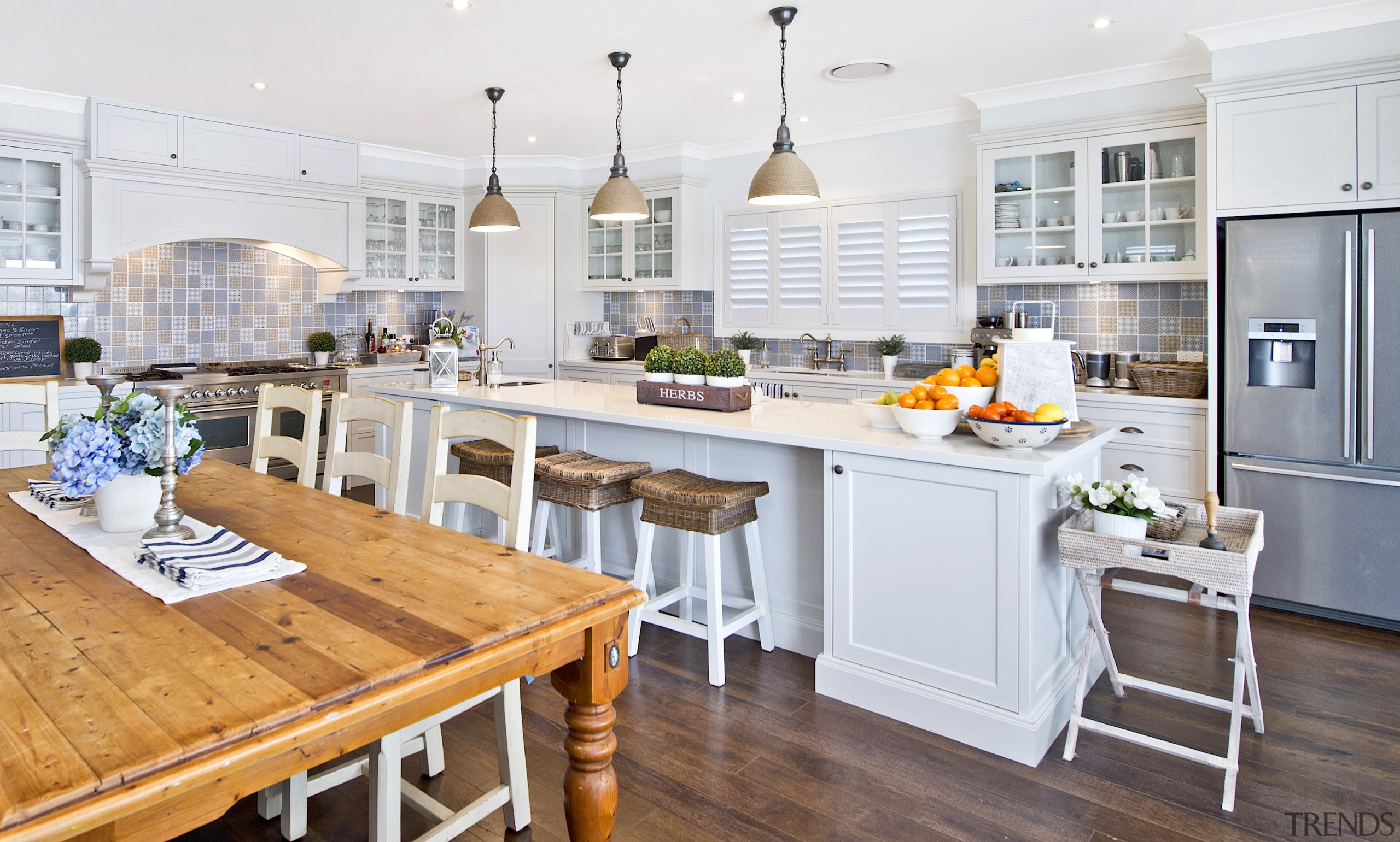 A traditional kitchen with glass-panelled upper cabinetry sits building, cabinetry, ceiling, countertop, cuisine classique, design, dining room, floor, flooring, furniture, hardwood, home, house, interior design, kitchen, laminate flooring, lighting, property, real estate, room, table, tile, white, wood, wood flooring, yellow, white