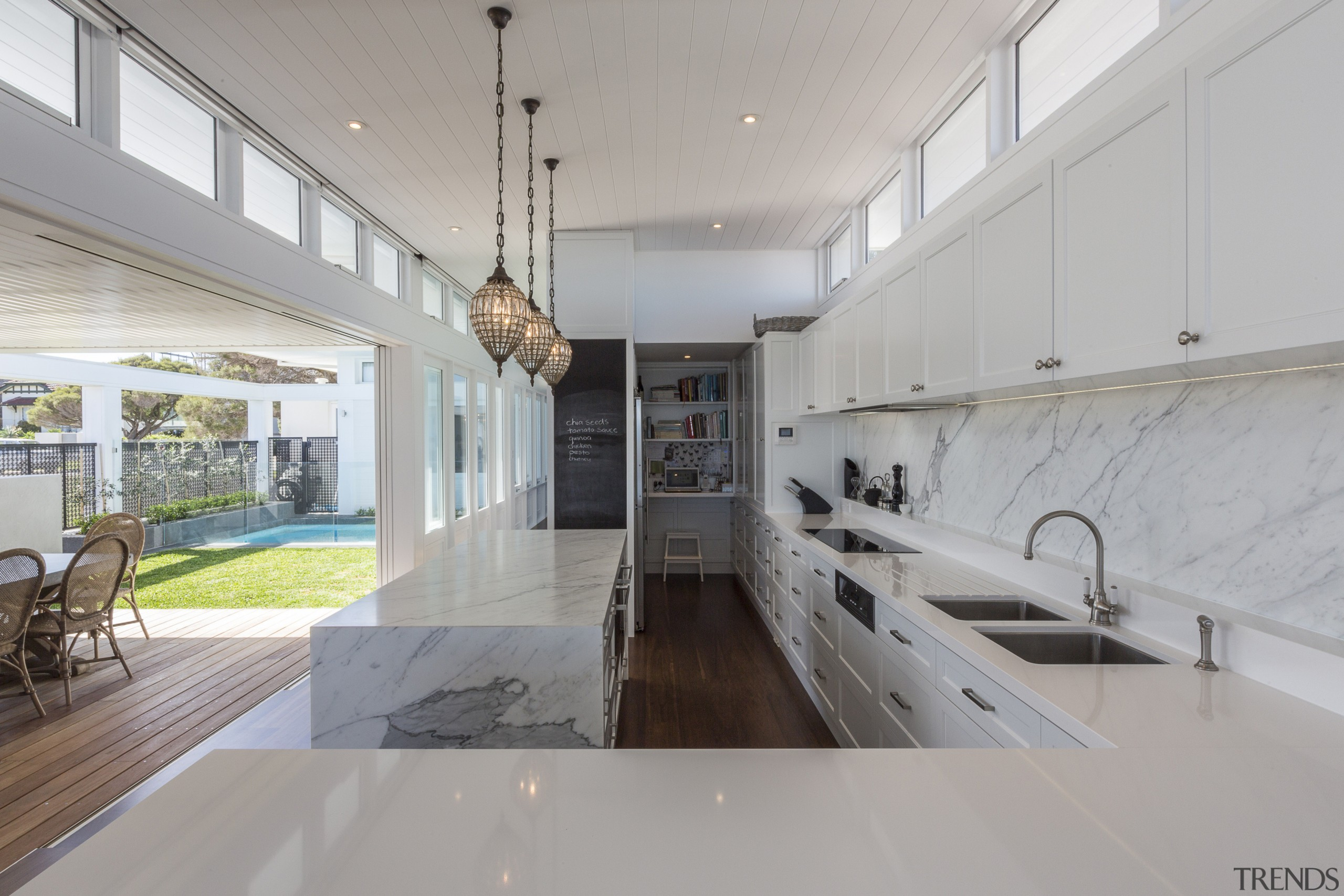 The kitchen and living area in this new architecture, countertop, house, interior design, real estate, gray