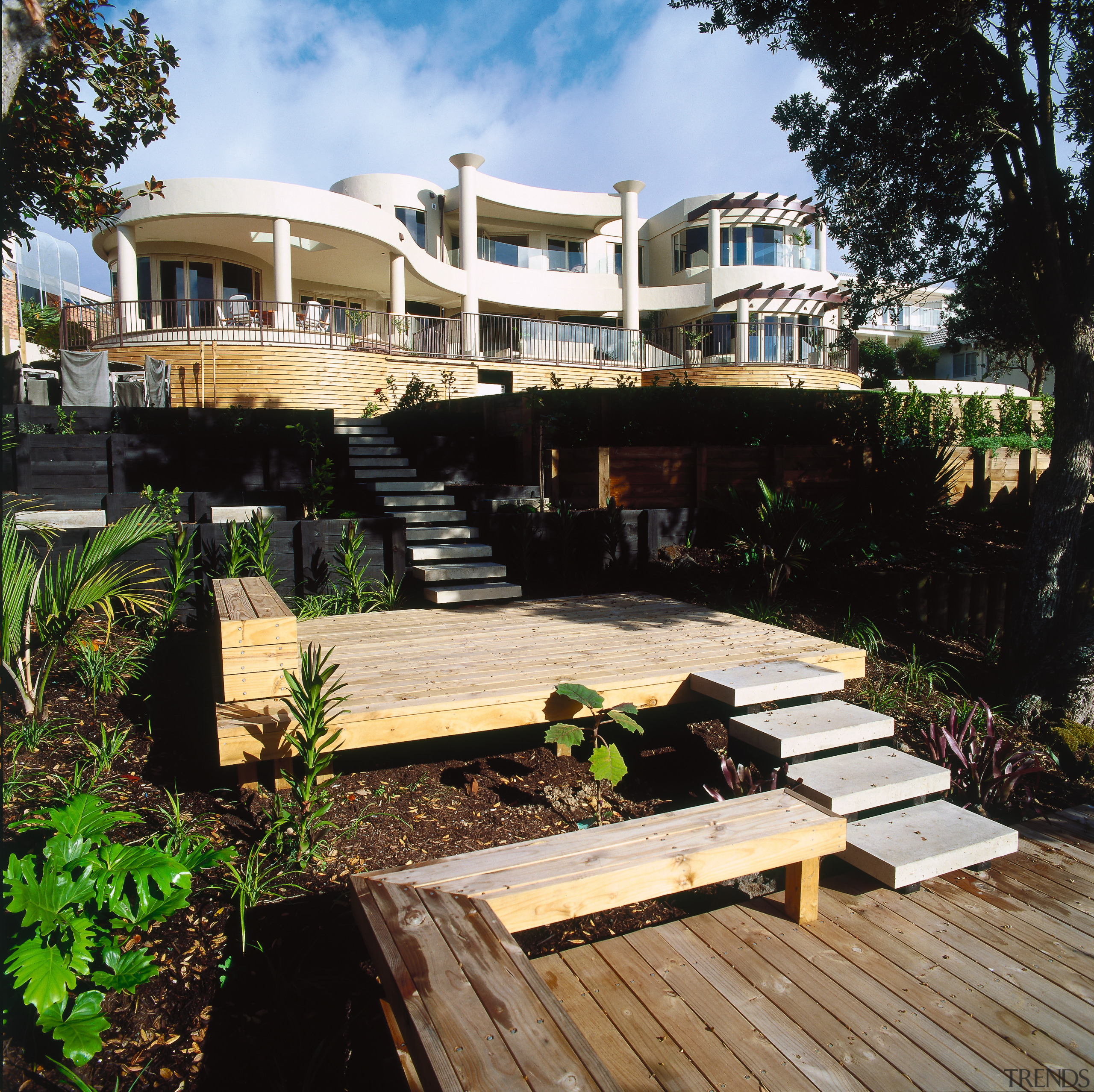 A view of the entire house from the architecture, cottage, deck, estate, home, house, outdoor structure, property, real estate, resort, black