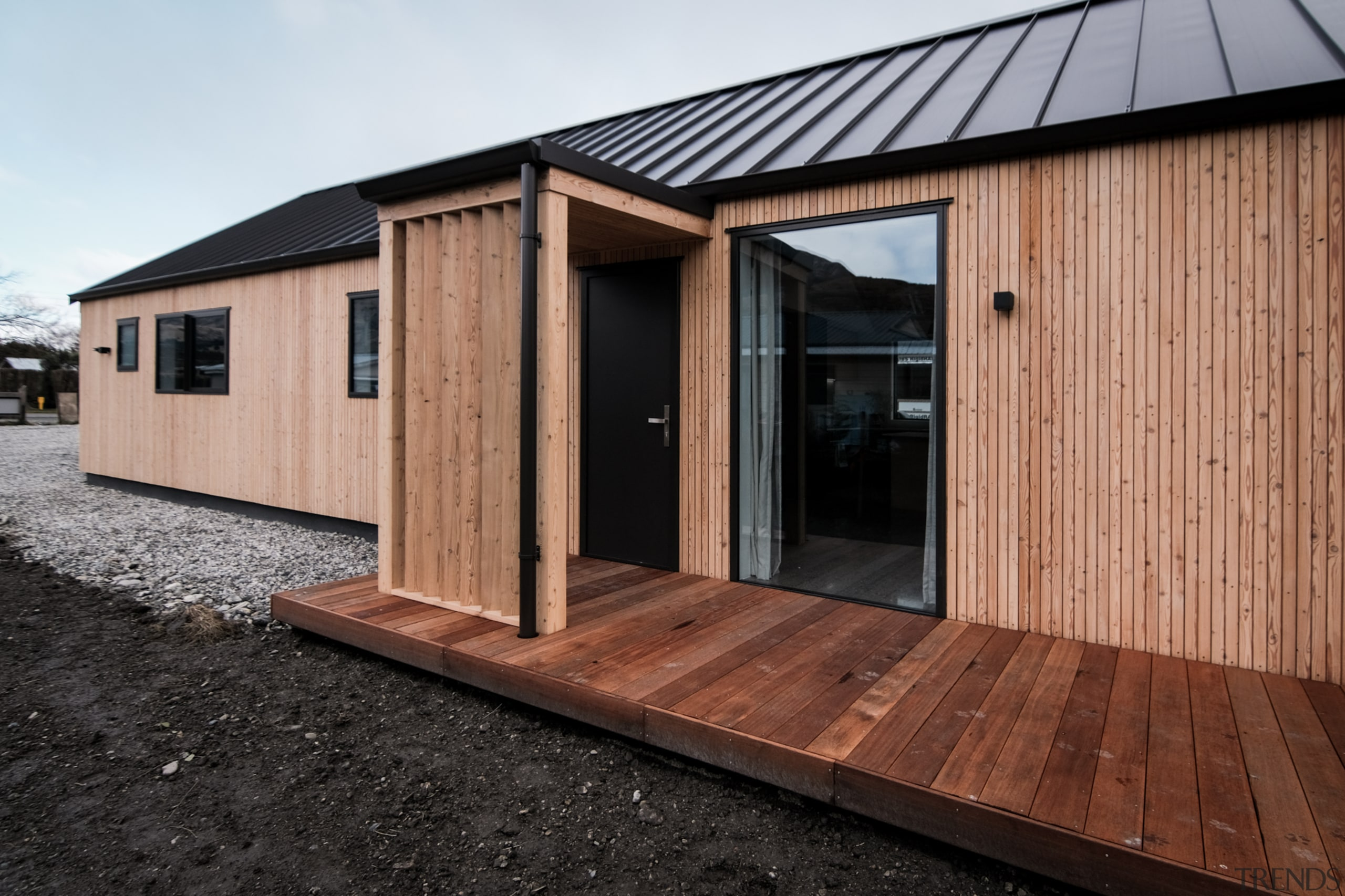 Timber cladding, plenty of full-height windows and rugged