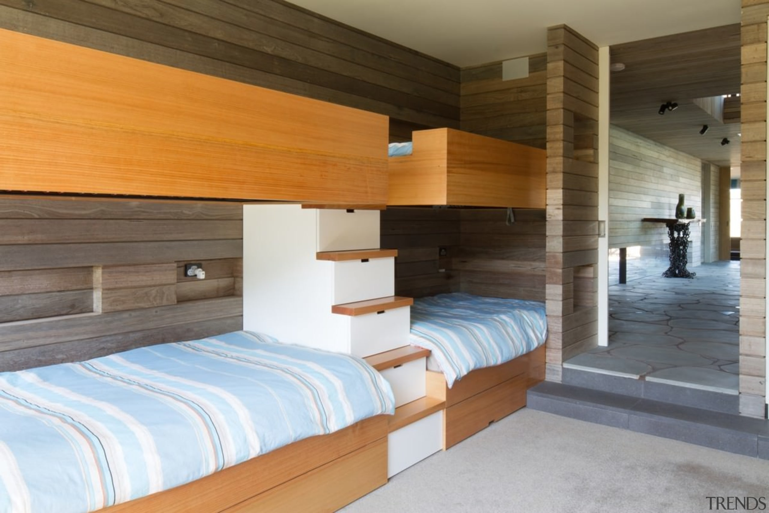 A beach house staple, this room features a architecture, bed frame, floor, house, interior design, property, real estate, room, suite, wood, brown