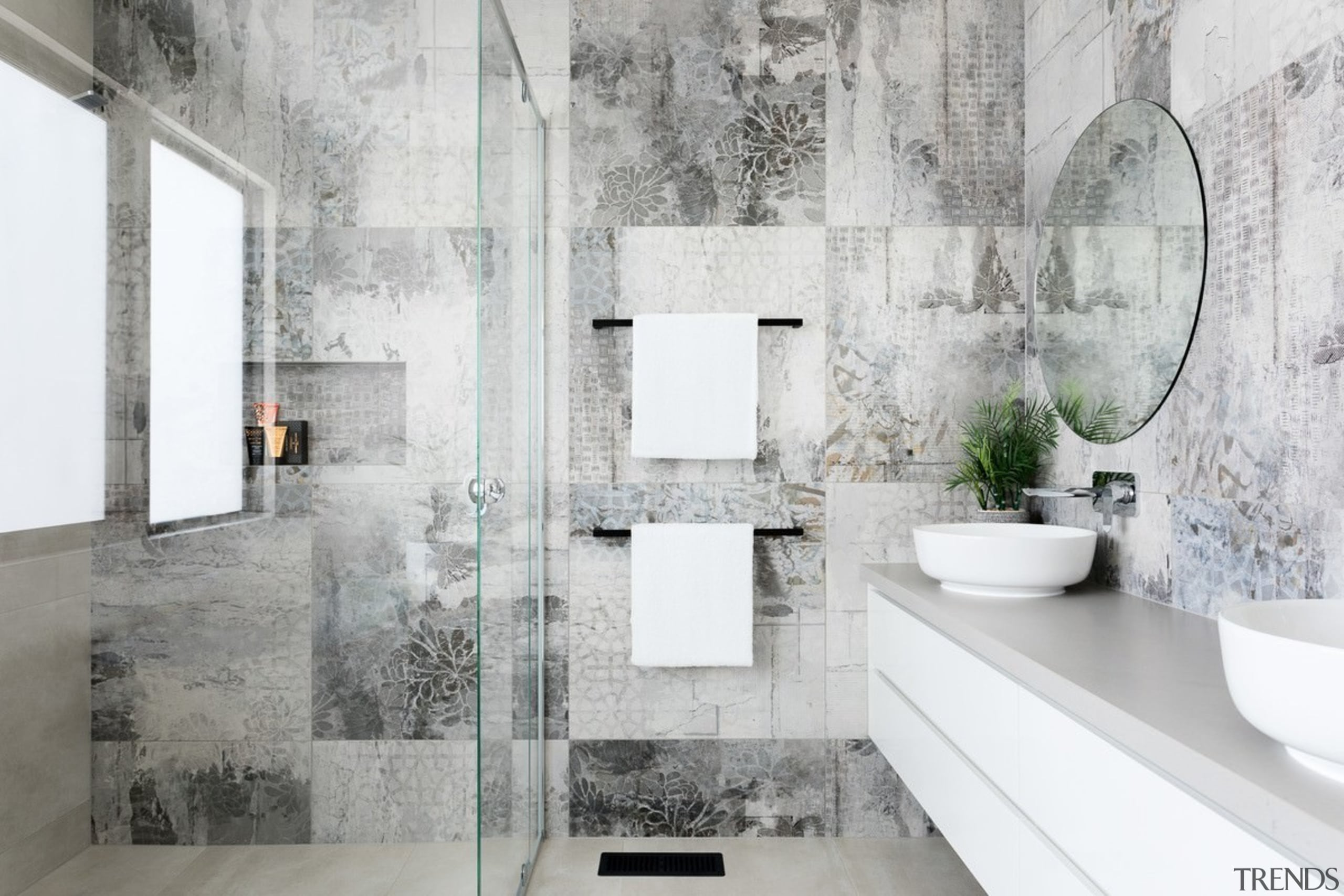 This unique wall pattern serves to set the architecture, bathroom, ceramic, floor, flooring, interior design, room, tap, tile, wall, gray, white