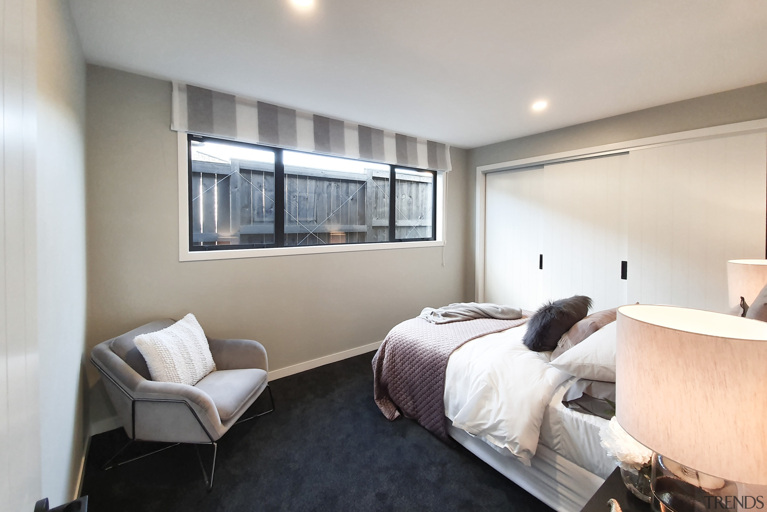 A spacious bedroom with built-in closets. - Elegance