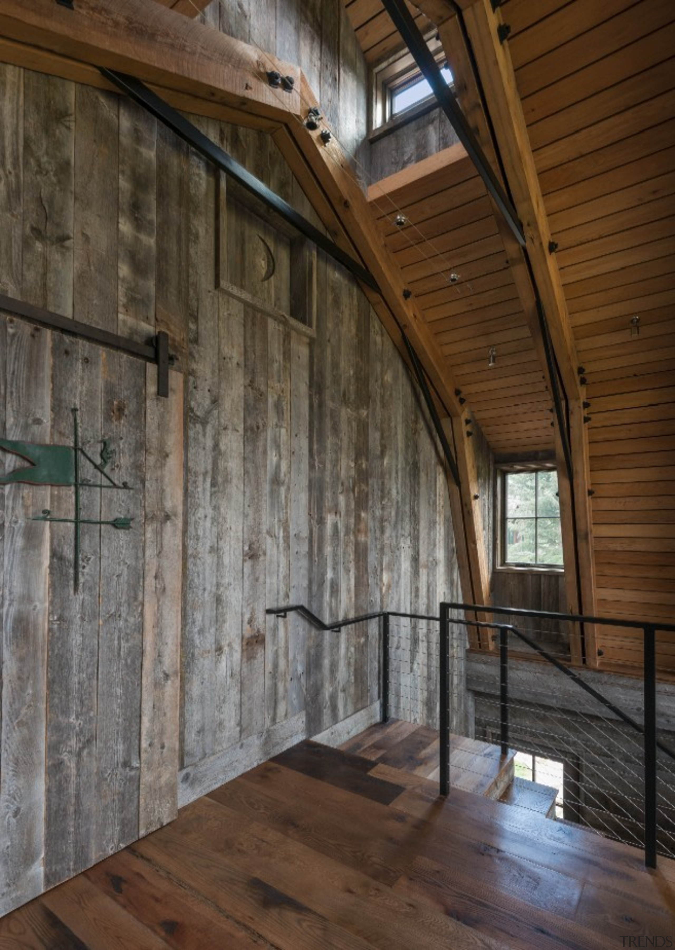Material use is careful and considered throughout - barn, beam, wall, wood, brown, gray