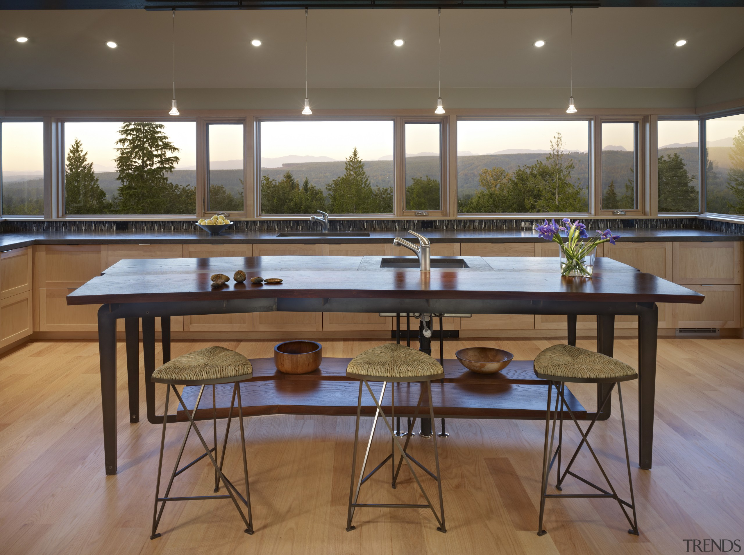 This home and kitchen was designed by Finne floor, flooring, furniture, interior design, recreation room, table, window, wood, brown
