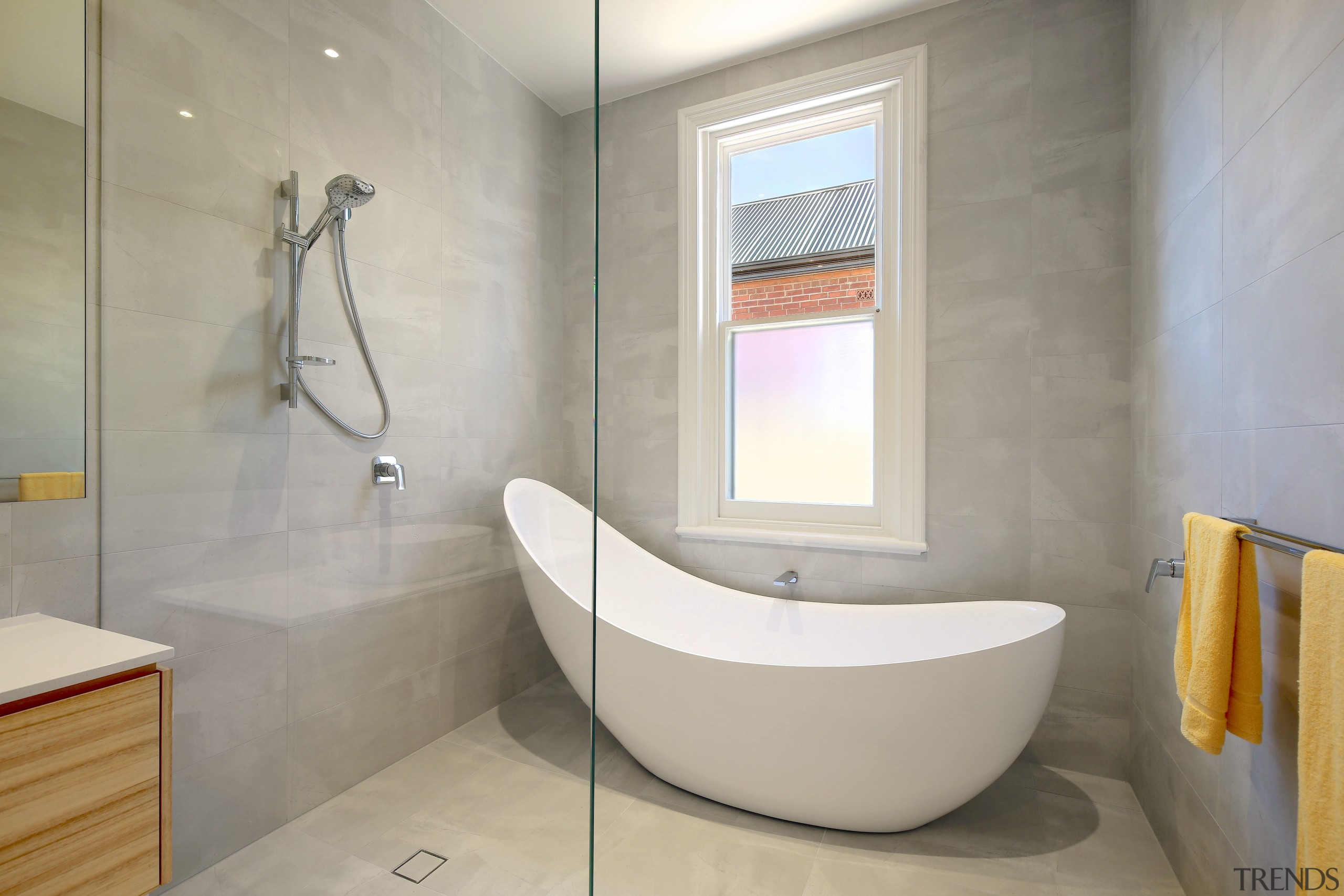 A wow factor bath was just one of architecture, bathroom, bathtub, building, ceiling, floor, flooring, house, interior design, material property, plumbing fixture, property, real estate, room, tap, tile, wall, gray