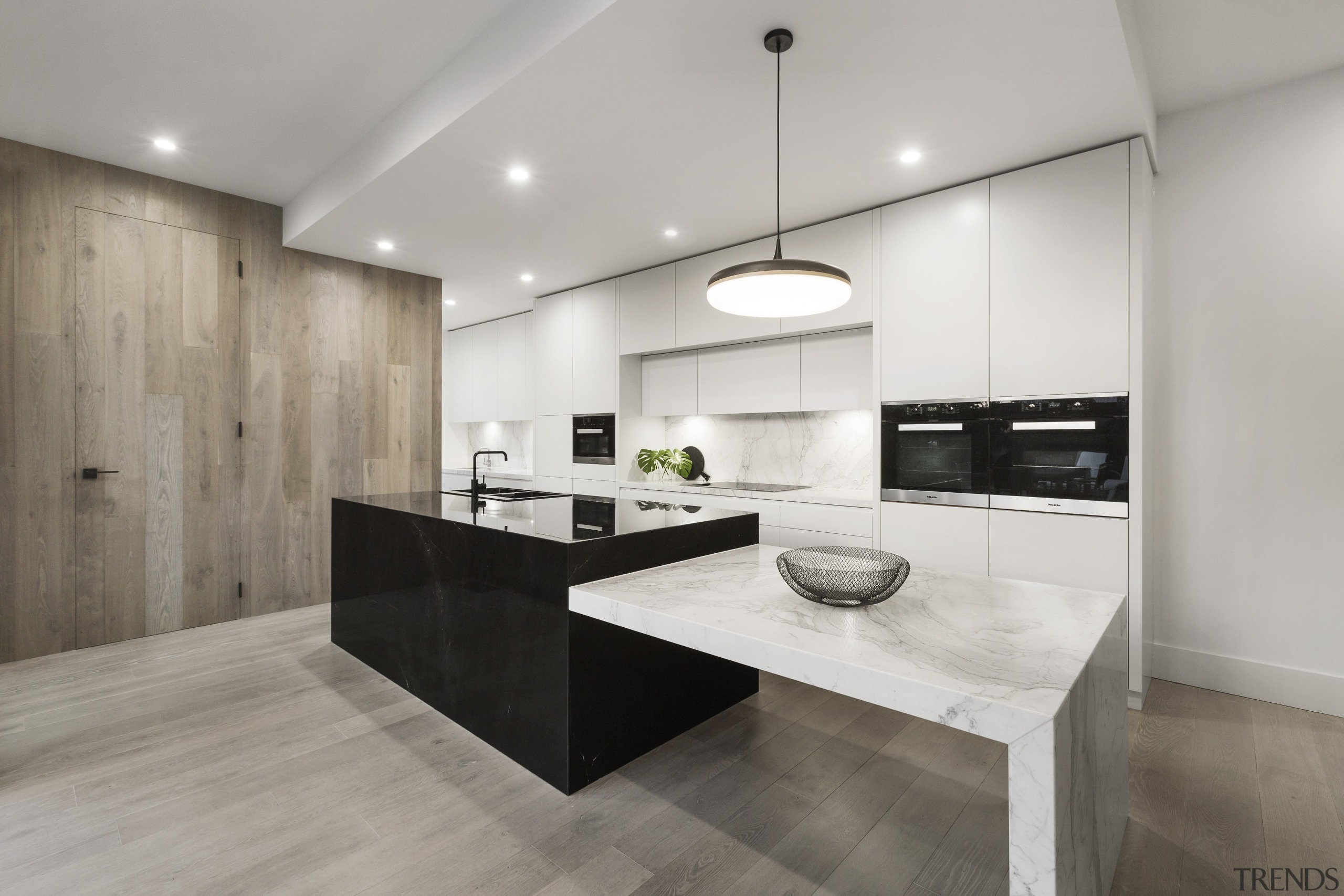 ​​​​​​​Black granite, white marble and wood – the architecture, countertop, floor, flooring, timber, interior design, kitchen, wood flooring, marble, LSA Architects
