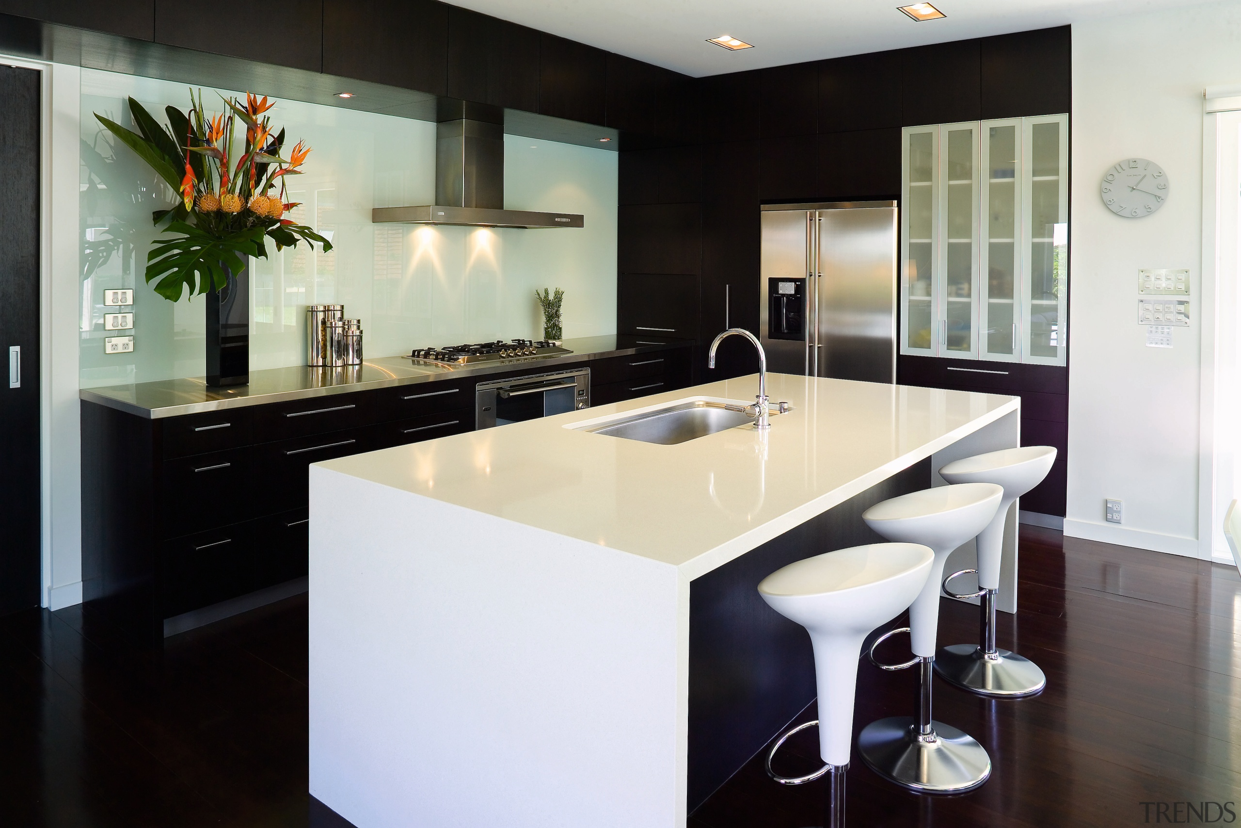 The deep island has enough bench space for cabinetry, countertop, interior design, kitchen, real estate, room, black, white