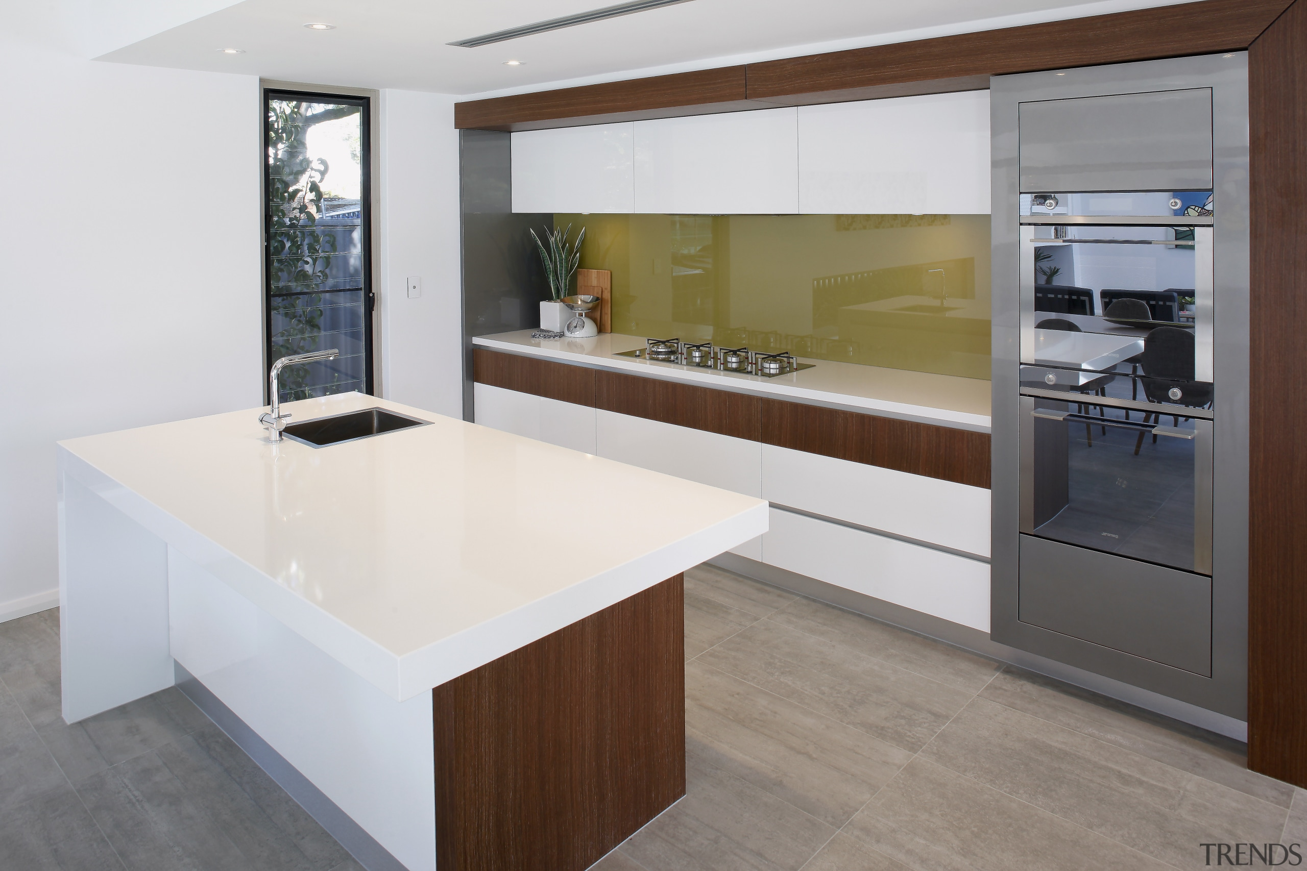 This award-winning kitchen features timber veneer framing around cabinetry, countertop, cuisine classique, floor, interior design, kitchen, real estate, white, gray
