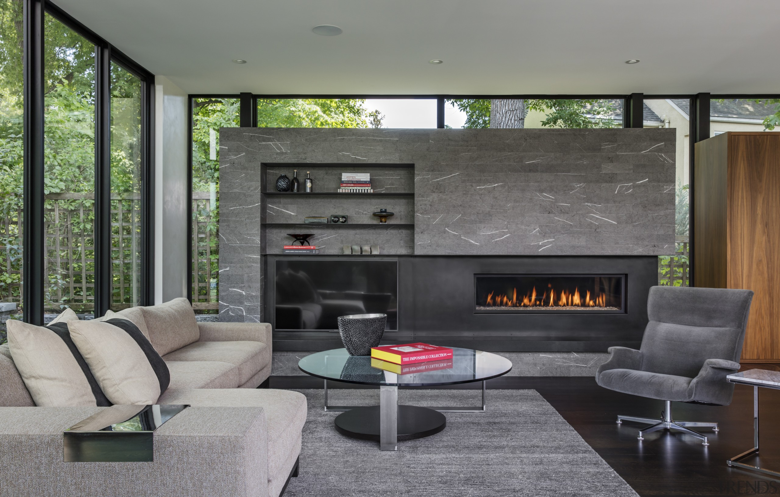 The fireplace has the sense of being a fireplace, hearth, house, interior design, living room, gray, black