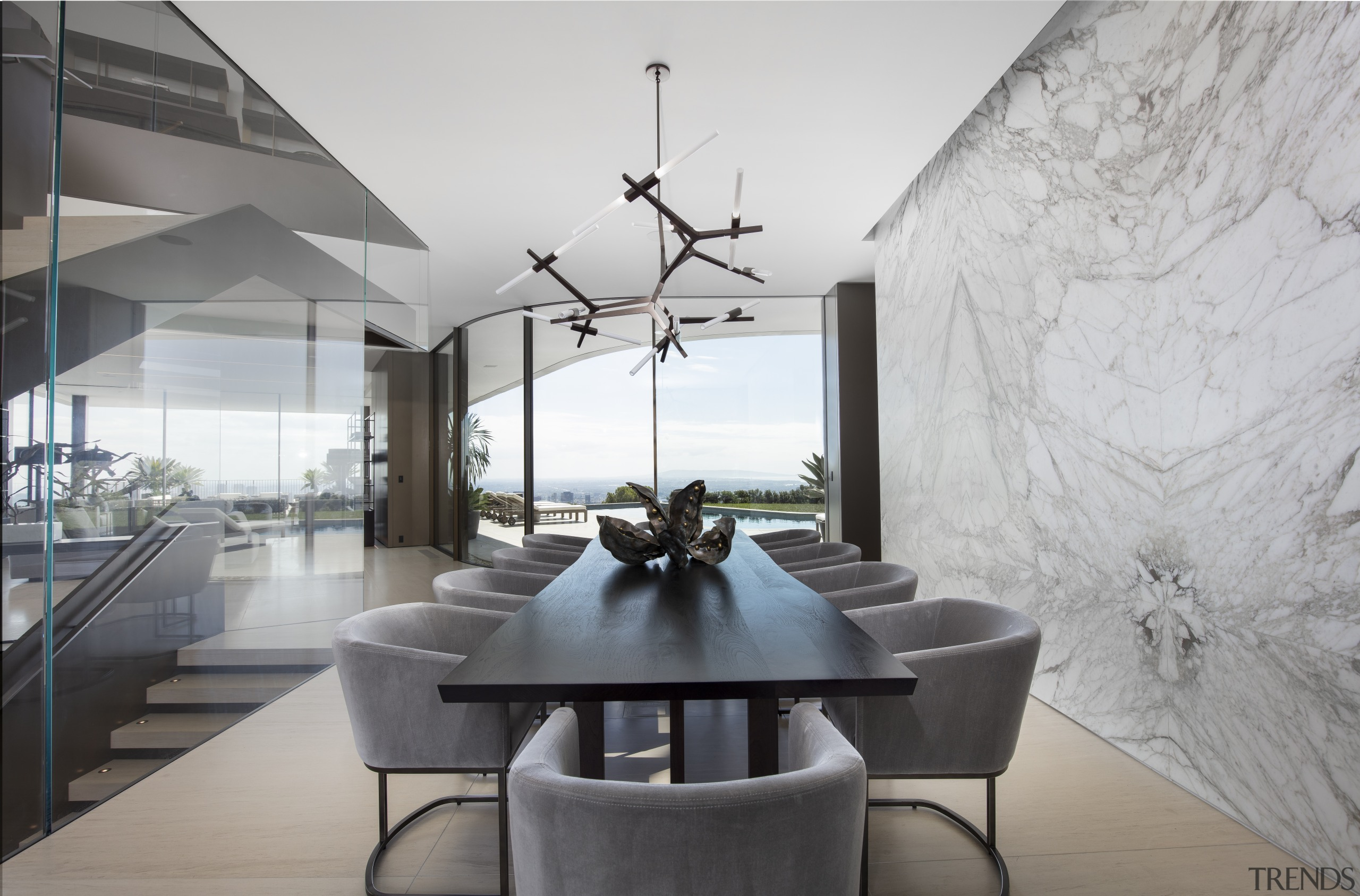 The dining space is at the centre of architecture, building, ceiling, coffee table, design, dining room, floor, furniture, home, house, interior design, living room, property, real estate, room, table, gray
