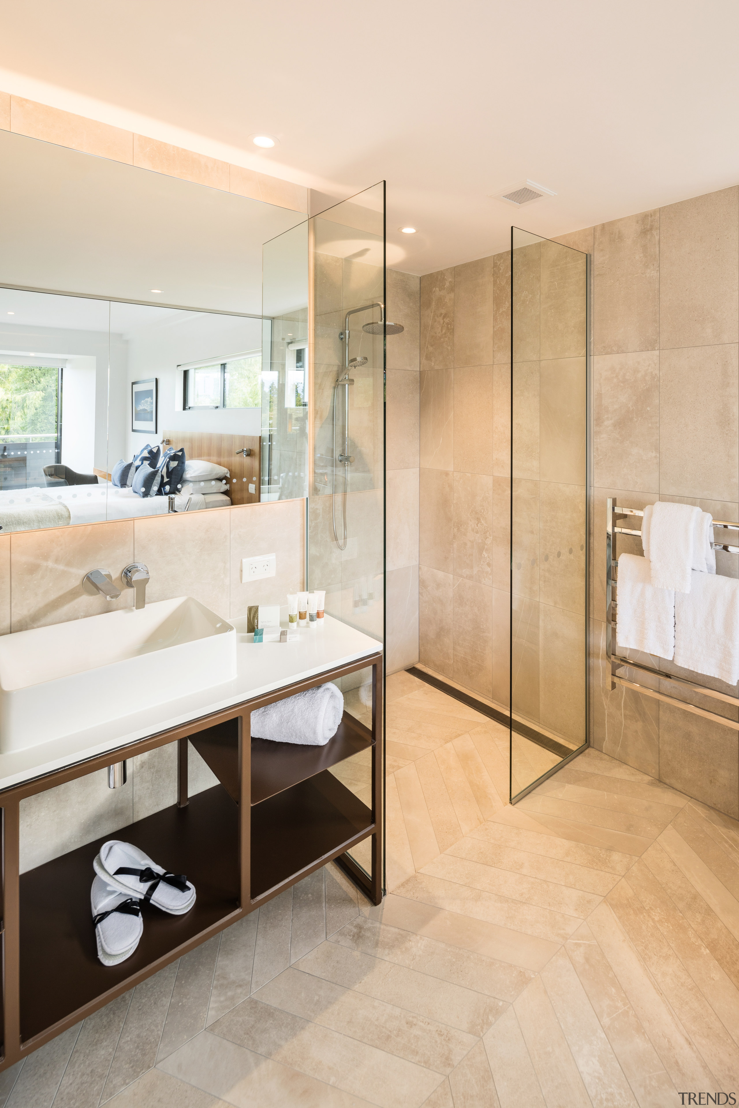 Clean-lined and contemporary, this custom steel-framed vanity is apartment, architecture, bathroom, beige, building, ceiling, floor, flooring, furniture, home, house, interior design, material property, plumbing fixture, property, real estate, room, tile, white, orange