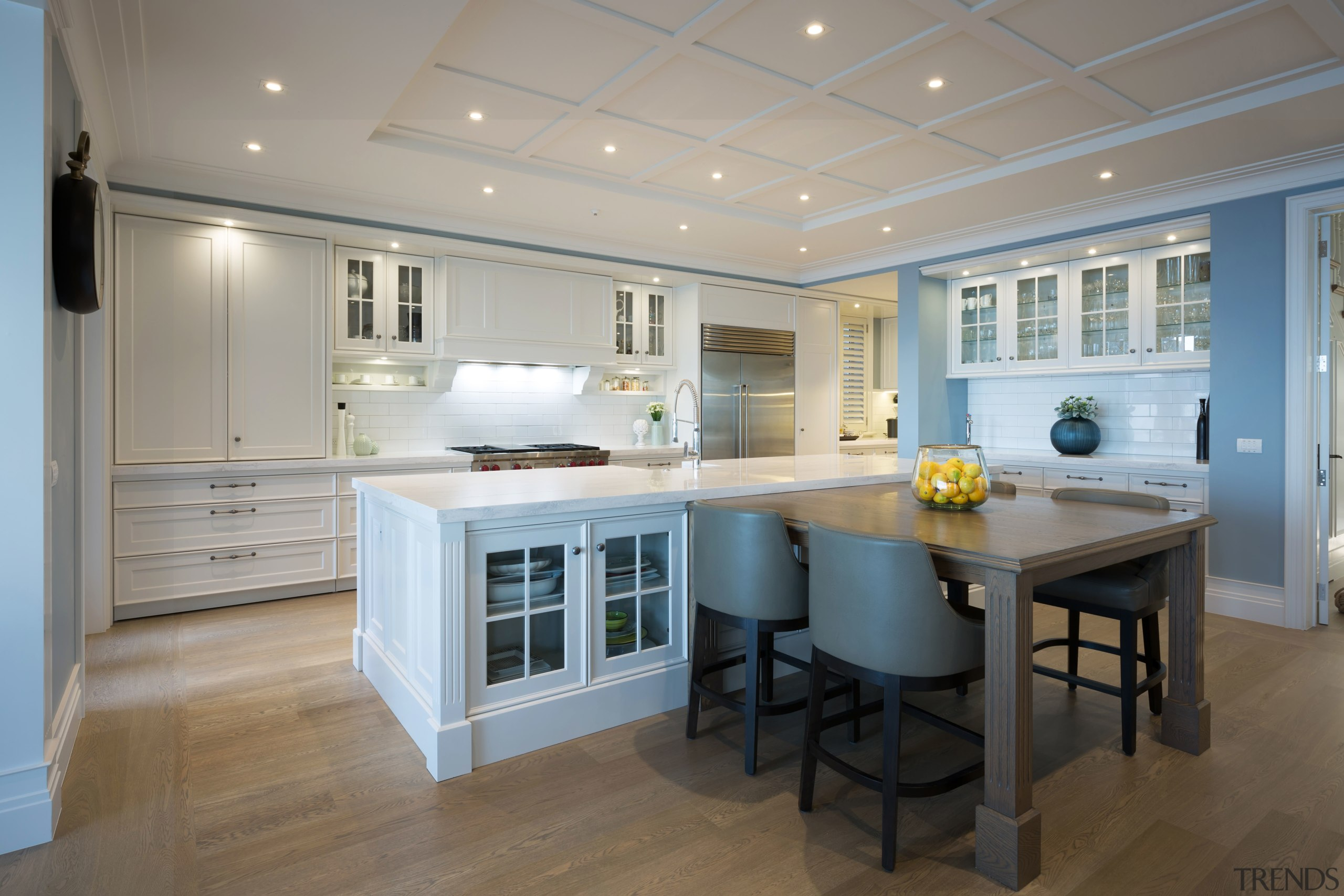 This kitchen combines traditional woodworking detail with large cabinetry, ceiling, countertop, cuisine classique, floor, flooring, home, interior design, kitchen, real estate, room, wood flooring, gray