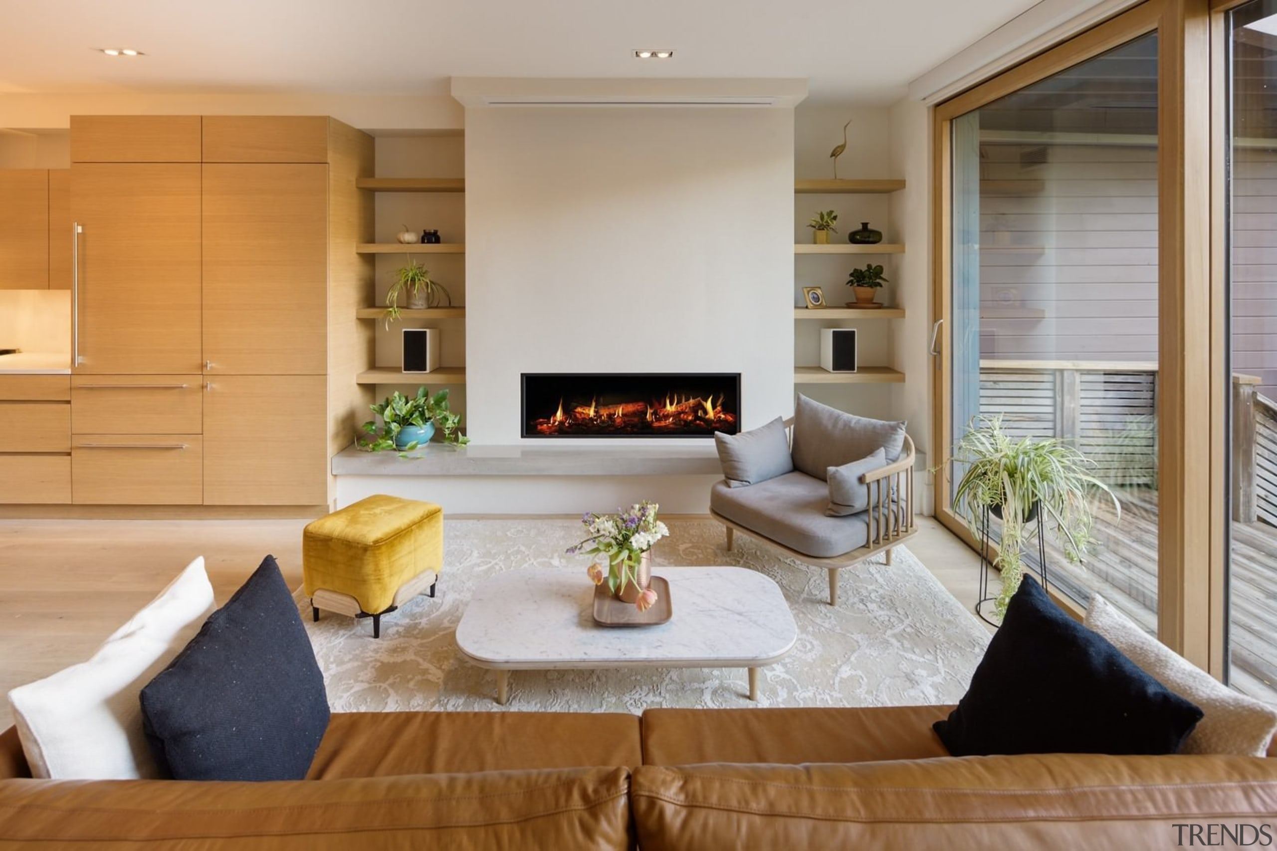 A large fireplace draws the eye in this home, interior design, living room, real estate, gray, brown