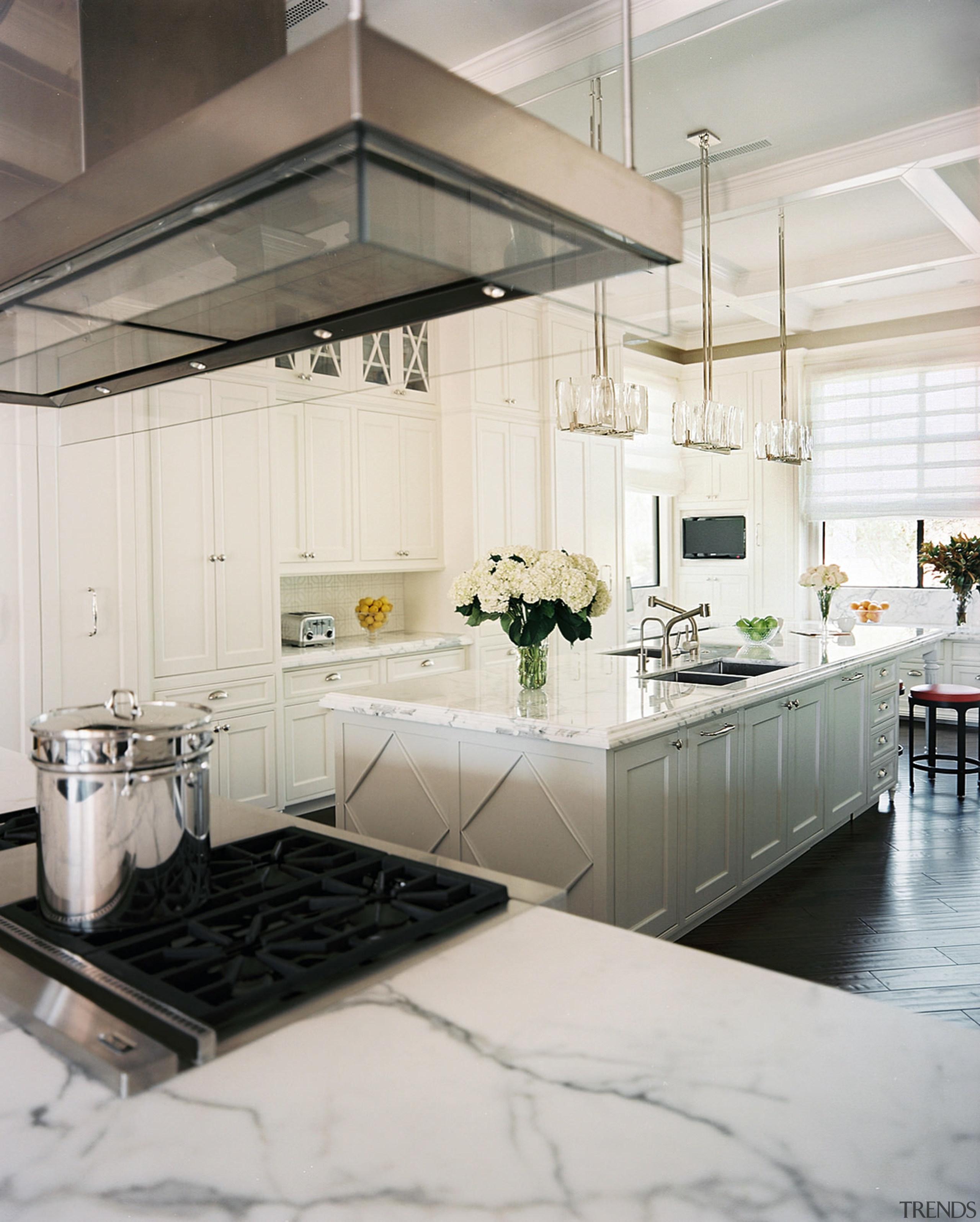 Sparkling pendant lights reinforce the sense that the countertop, cuisine classique, floor, flooring, interior design, kitchen, room, white, gray