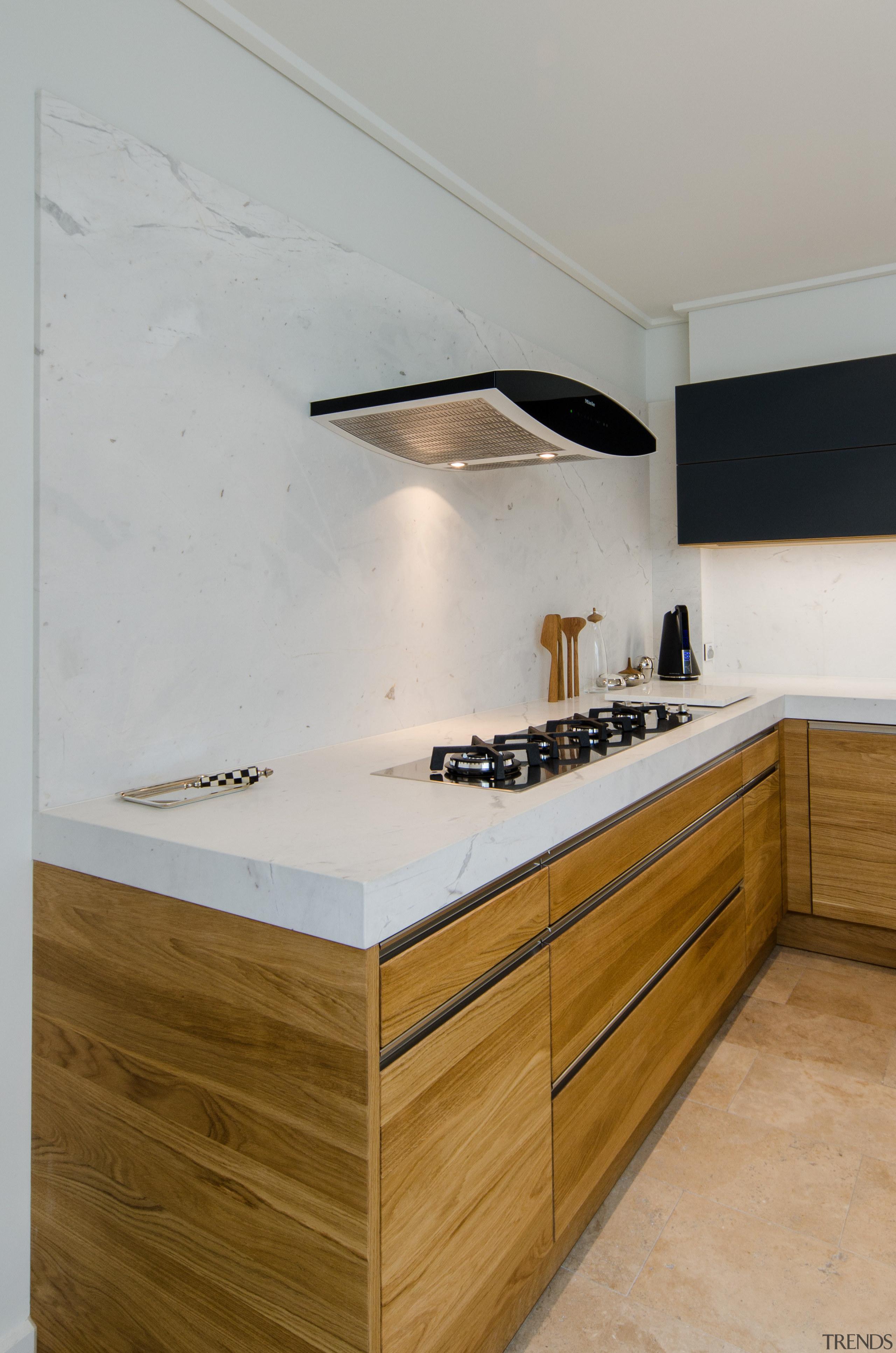 The Miele DA 7000 D Aura Island Rangehood cabinetry, countertop, cuisine classique, floor, interior design, kitchen, plywood, product design, room, sink, tap, wood, gray, brown