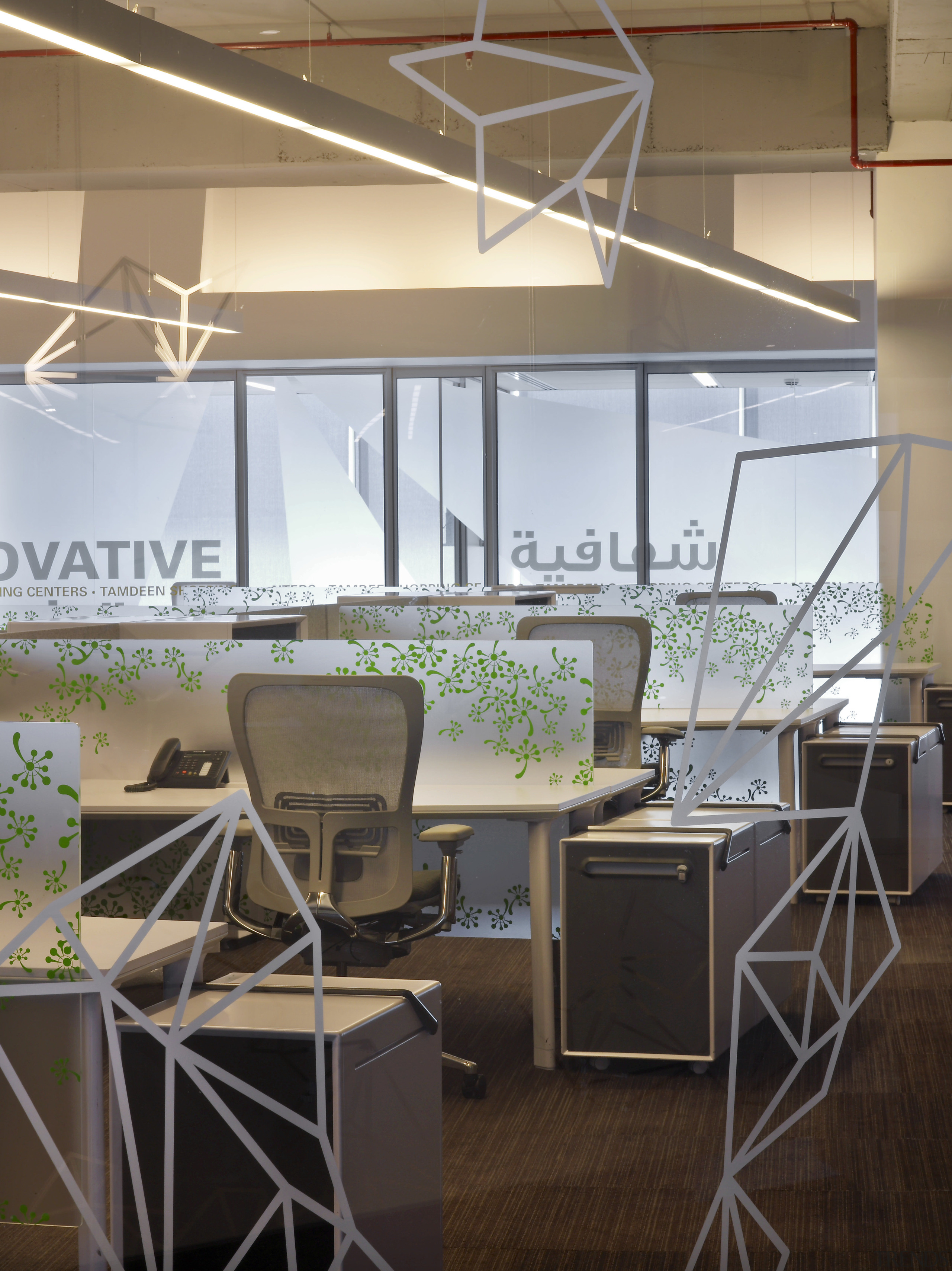 Interior with desks and grey geometrical designs. - daylighting, furniture, glass, interior design, office, product design, black, gray